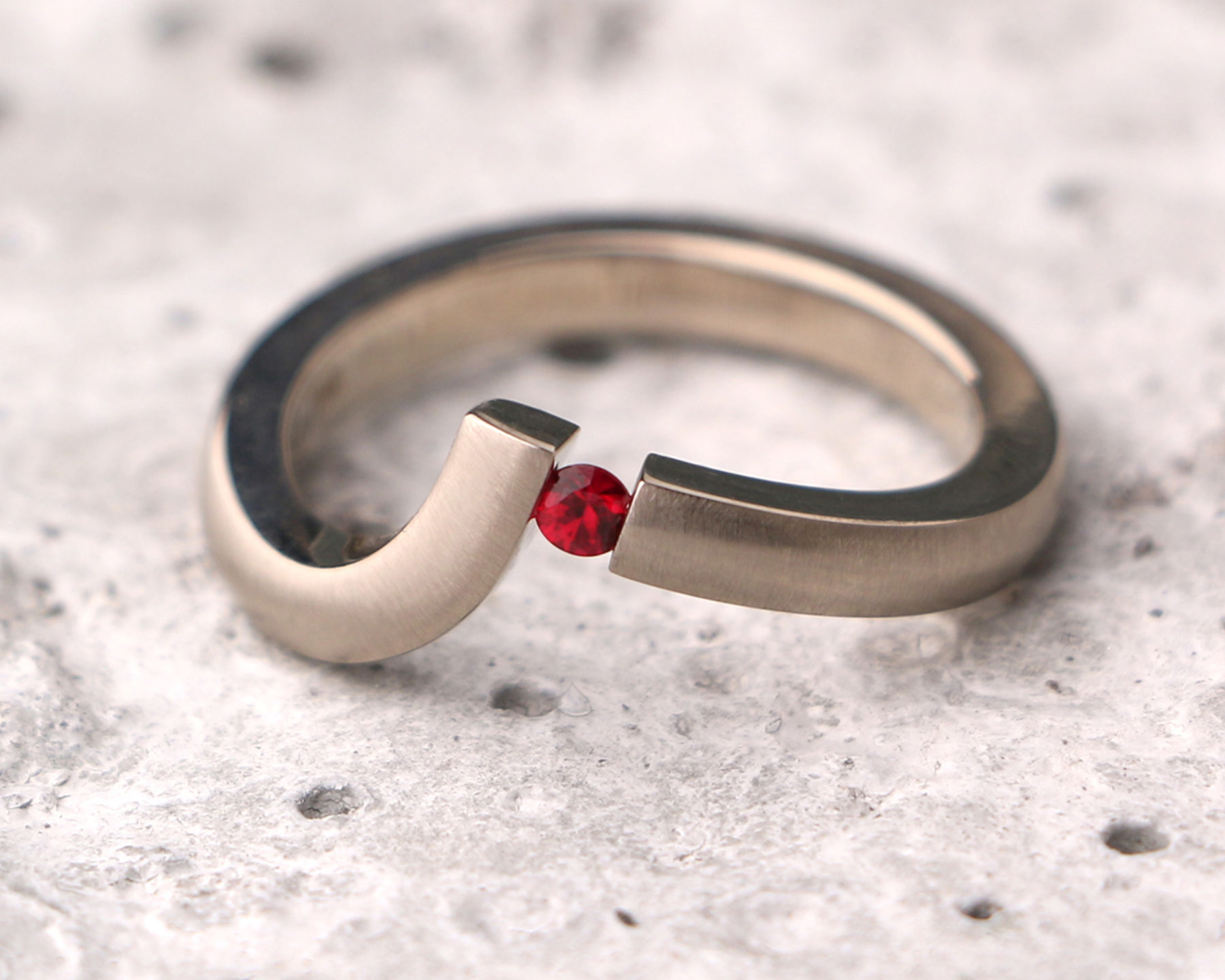 Suspended tension-set ruby ring