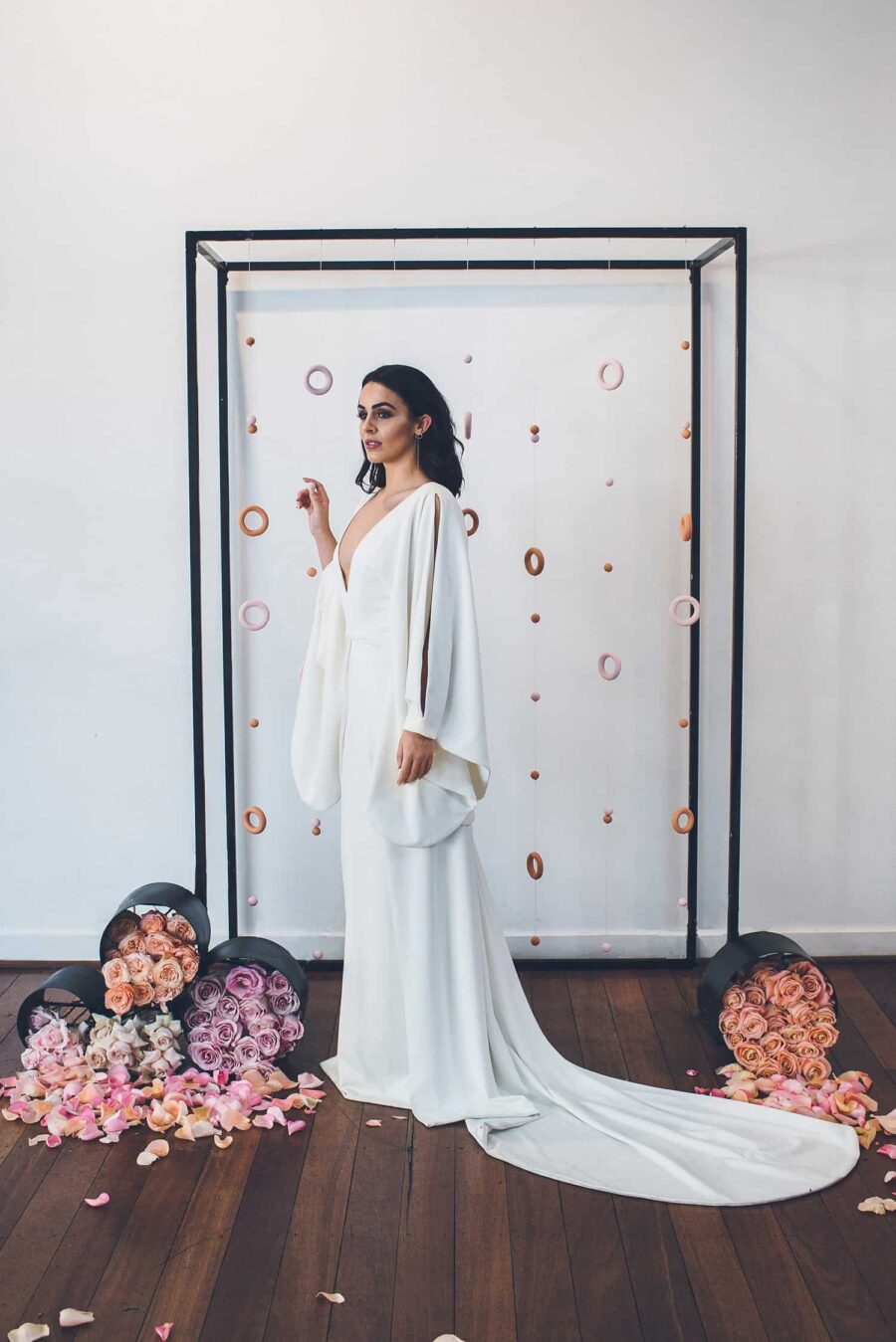 minimal wedding dress with sculptural sleeves by One Day Bridal