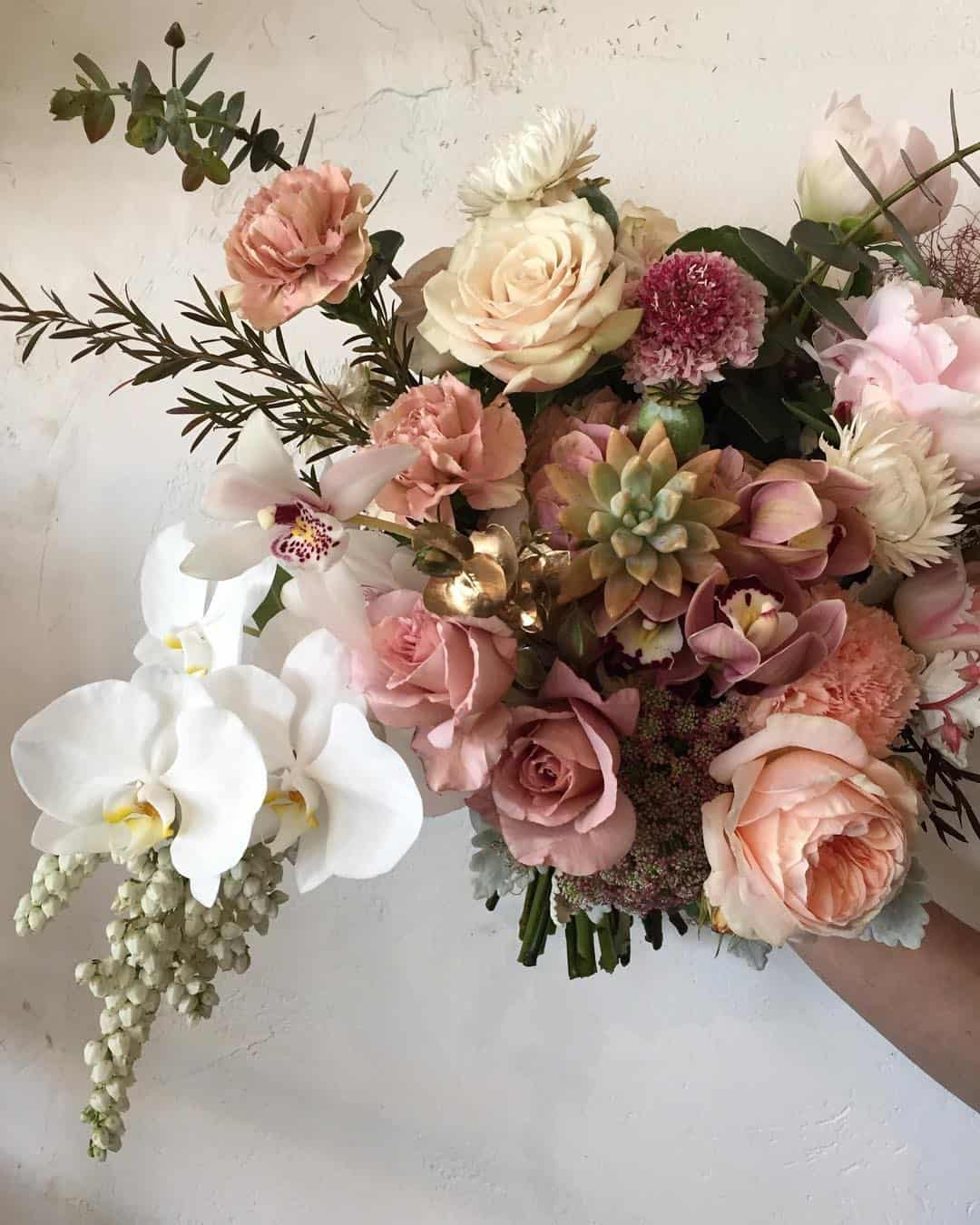 unstructured blush bouquet with roses and orchids