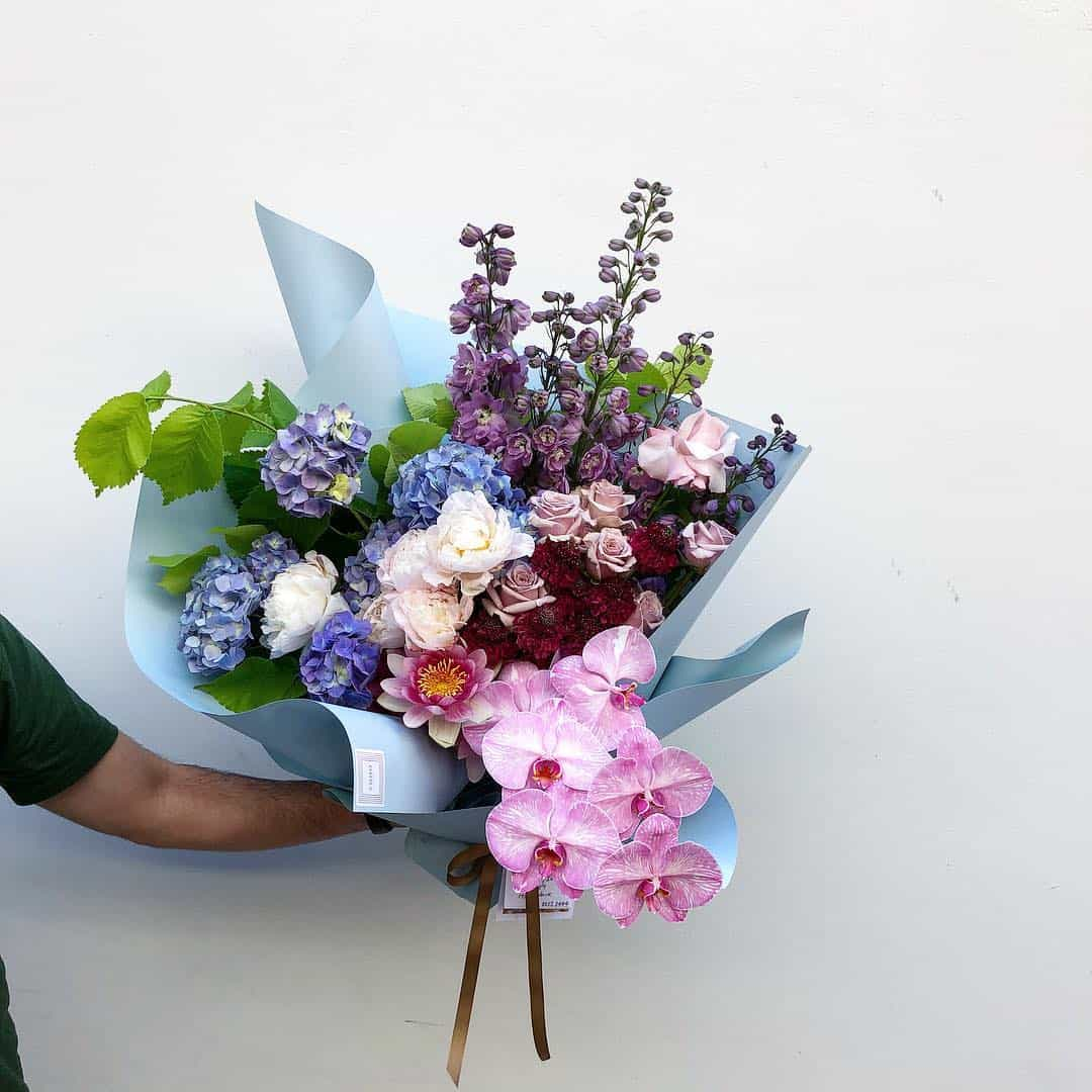 unstructured bouquet with roses, hydranegea and orchids