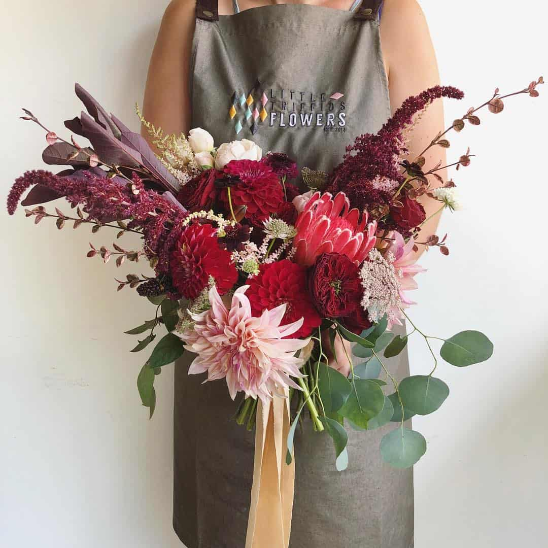 blush burgundy bouquet with dahlias and protea