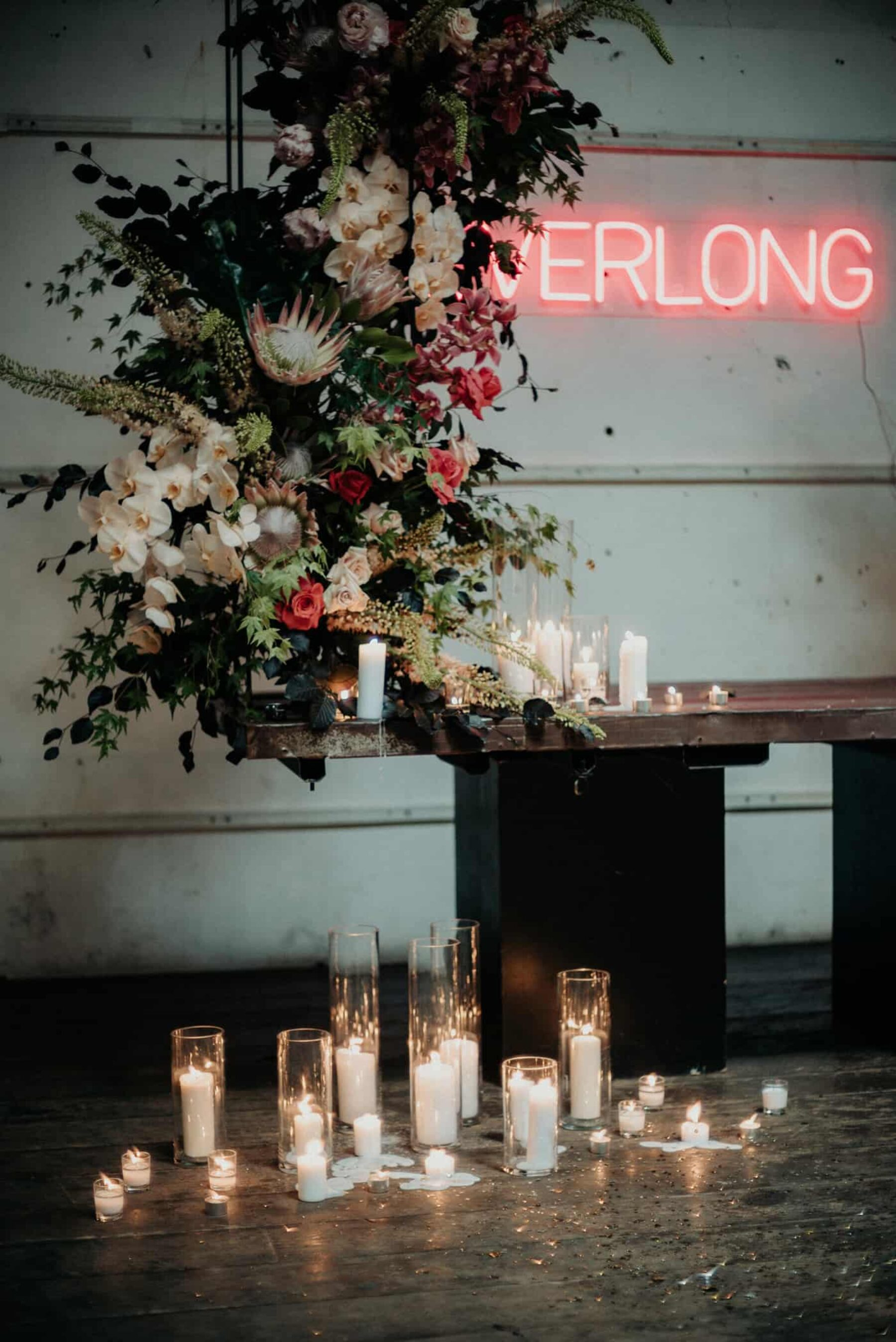 industrial wedding with neon 'Everlong' sign