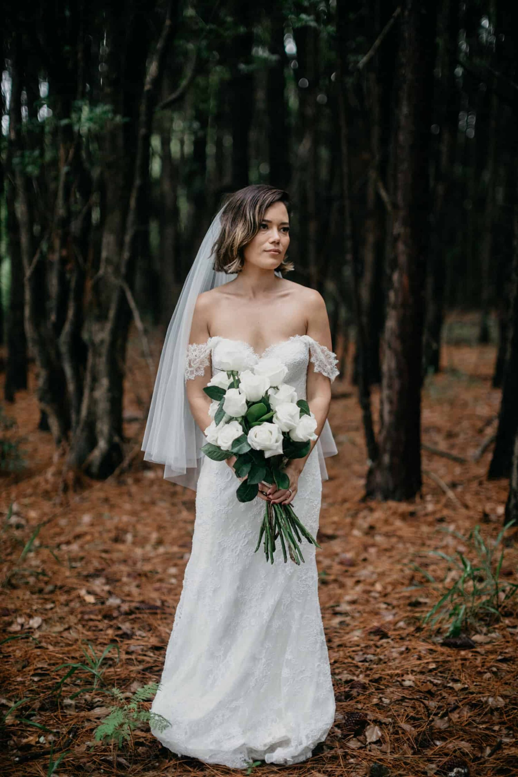 strapless wedding dress and classic white and green bouquet