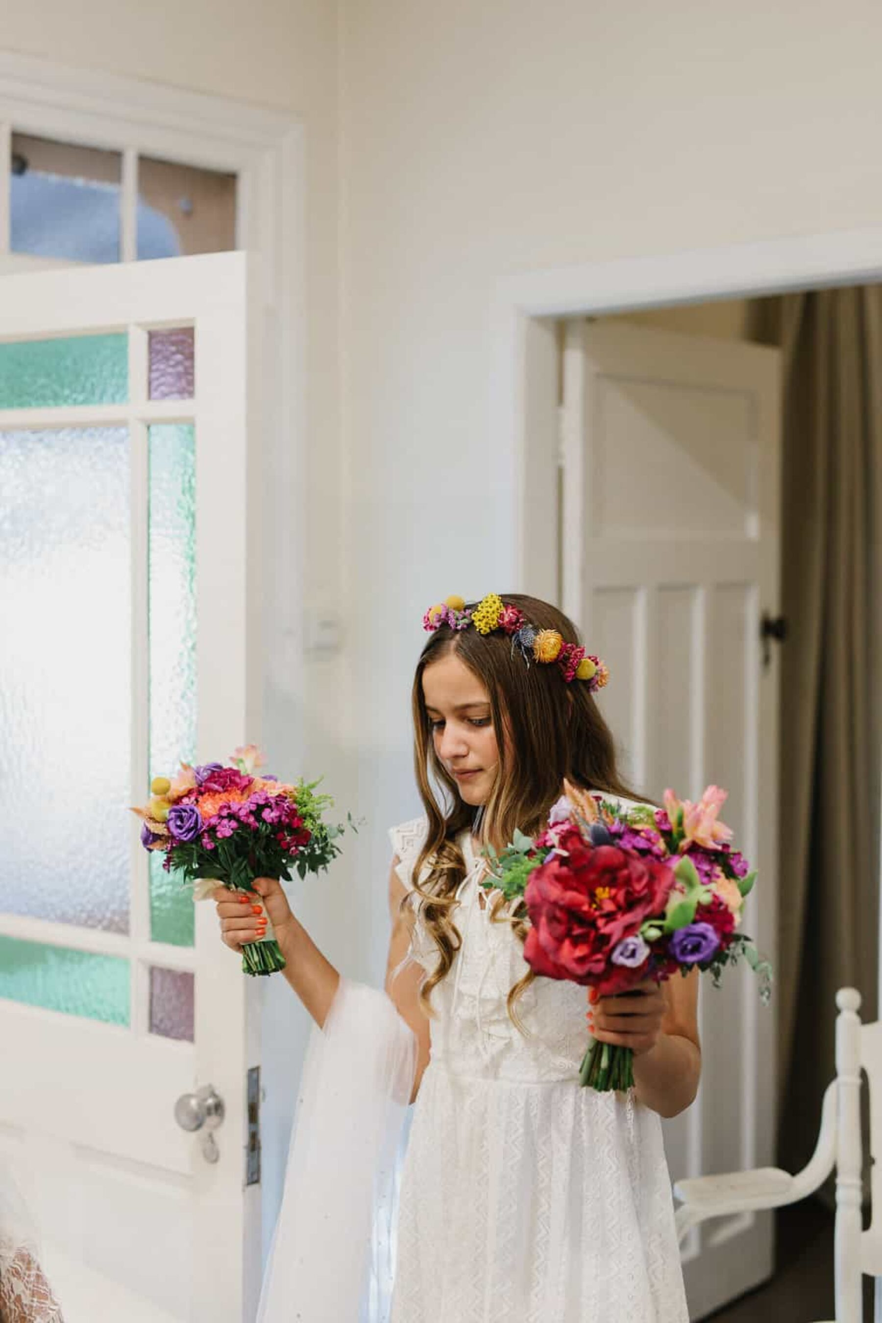 flower girl with crown and colourful bouquet