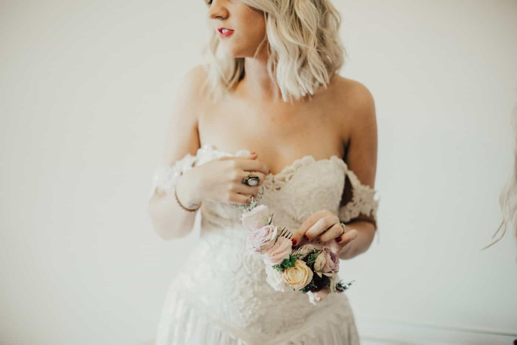 Boho bride in vintage lace strapless wedding dress