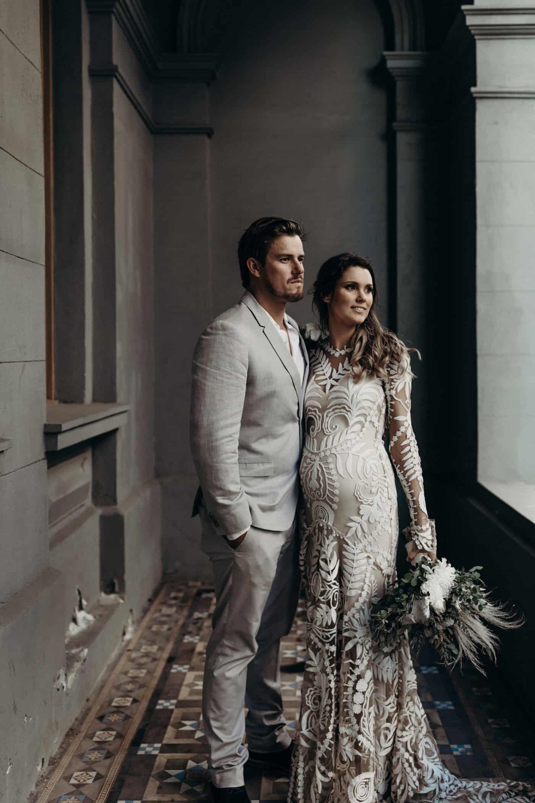 pregnant bride in long sleeve lace wedding dress by Rue de Siene