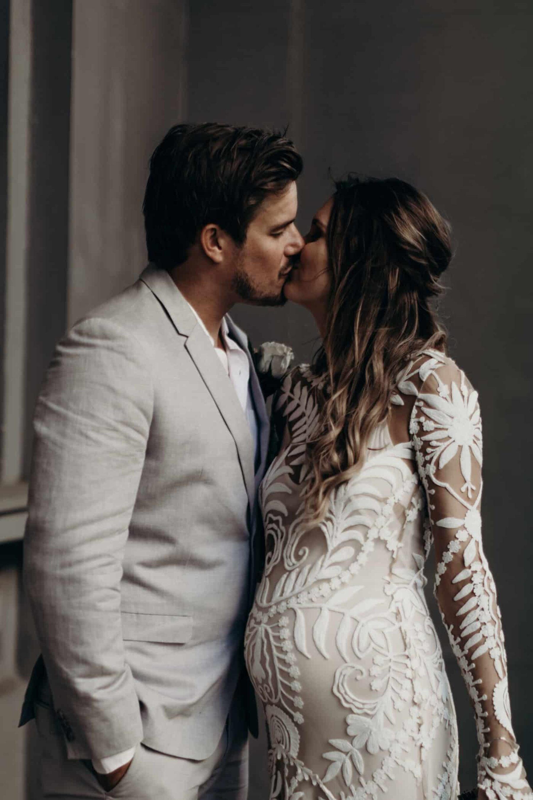 pregnant bride in long sleeve lace wedding dress by Rue de Siene