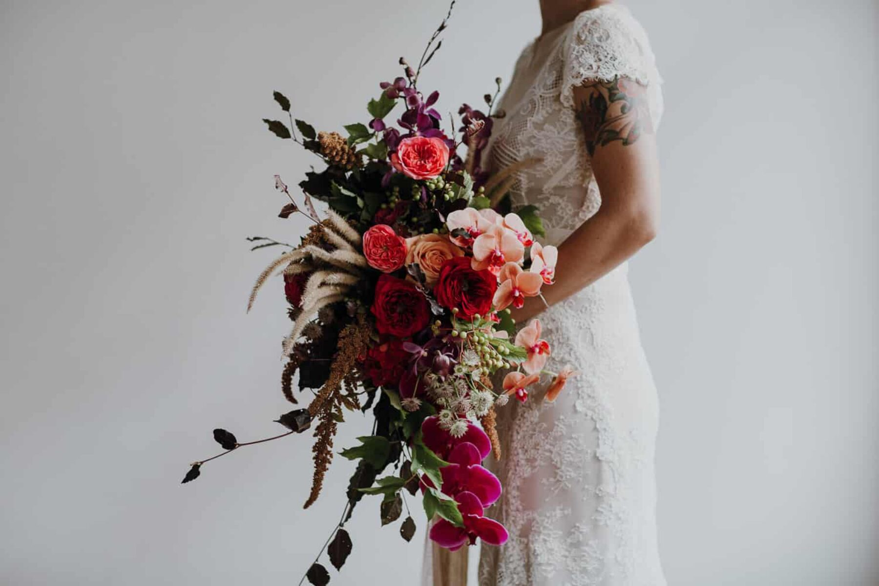 vibrant bridal bouquet with wild grass and orchids