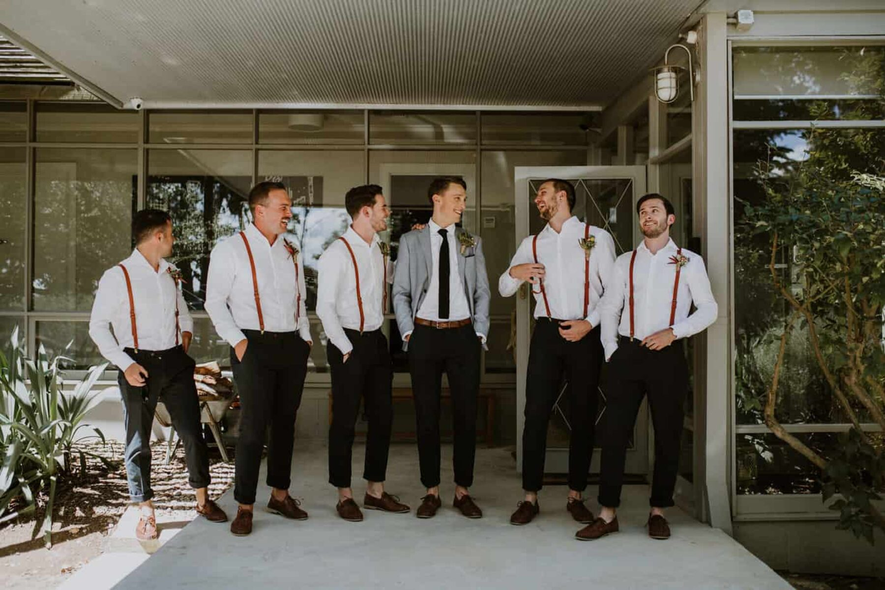 dapper groom and casual groomsmen in braces