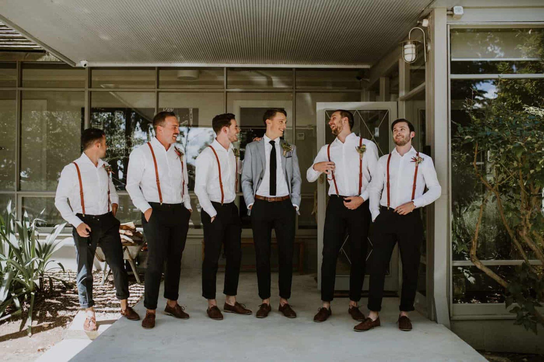 dapper groom and casual groomsmen in braces