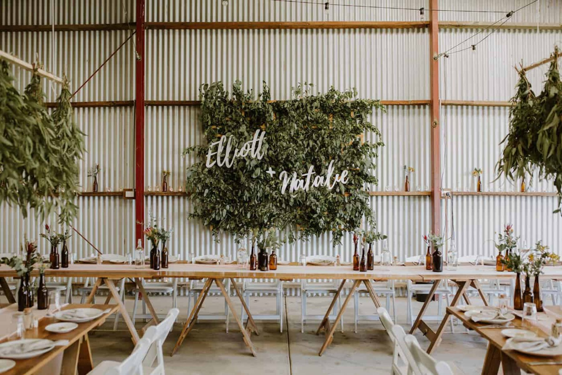 barn wedding with foliage wall