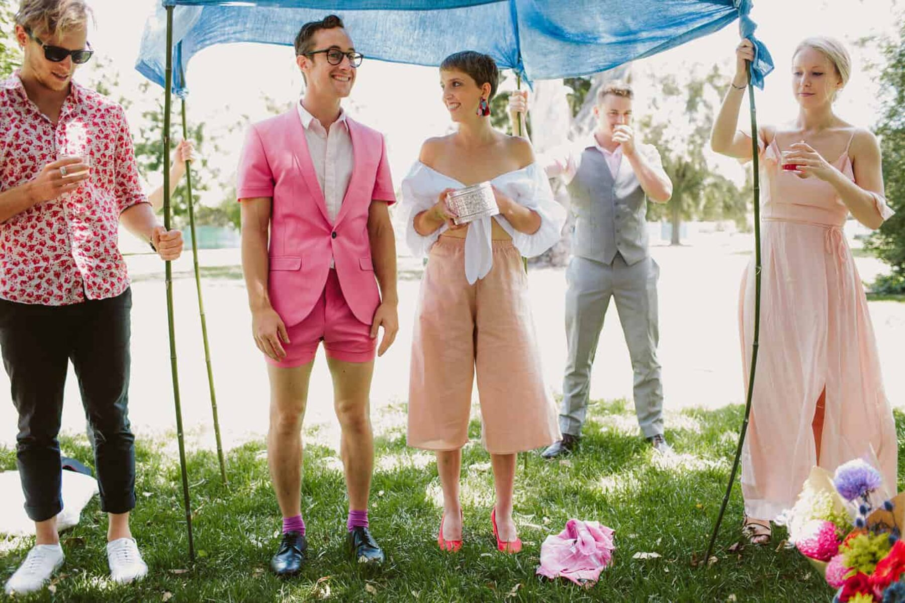 quirky bride and groom in pink