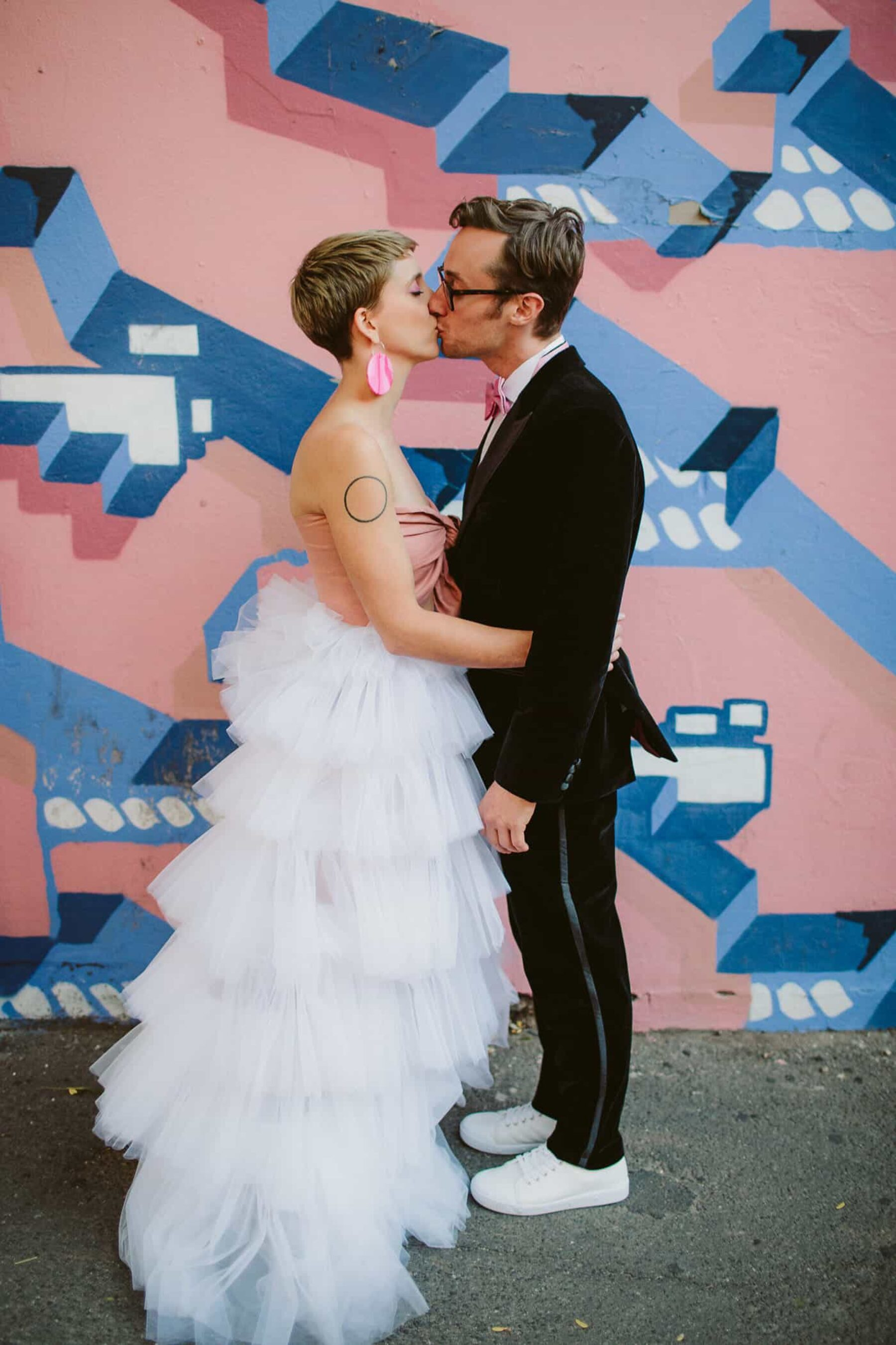 quirky bride and groom with street art back drop