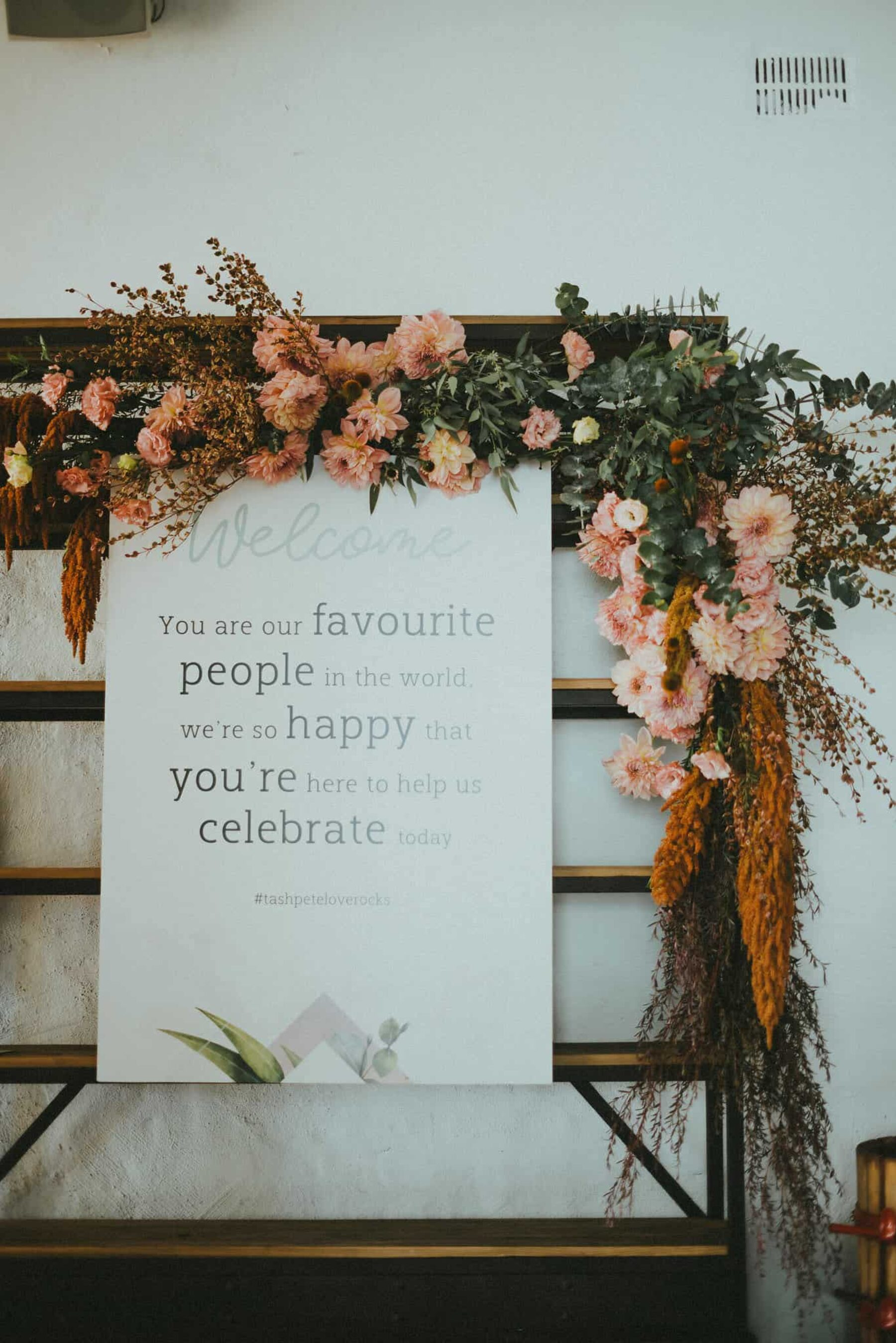 wedding welcome sign with blush dahlias