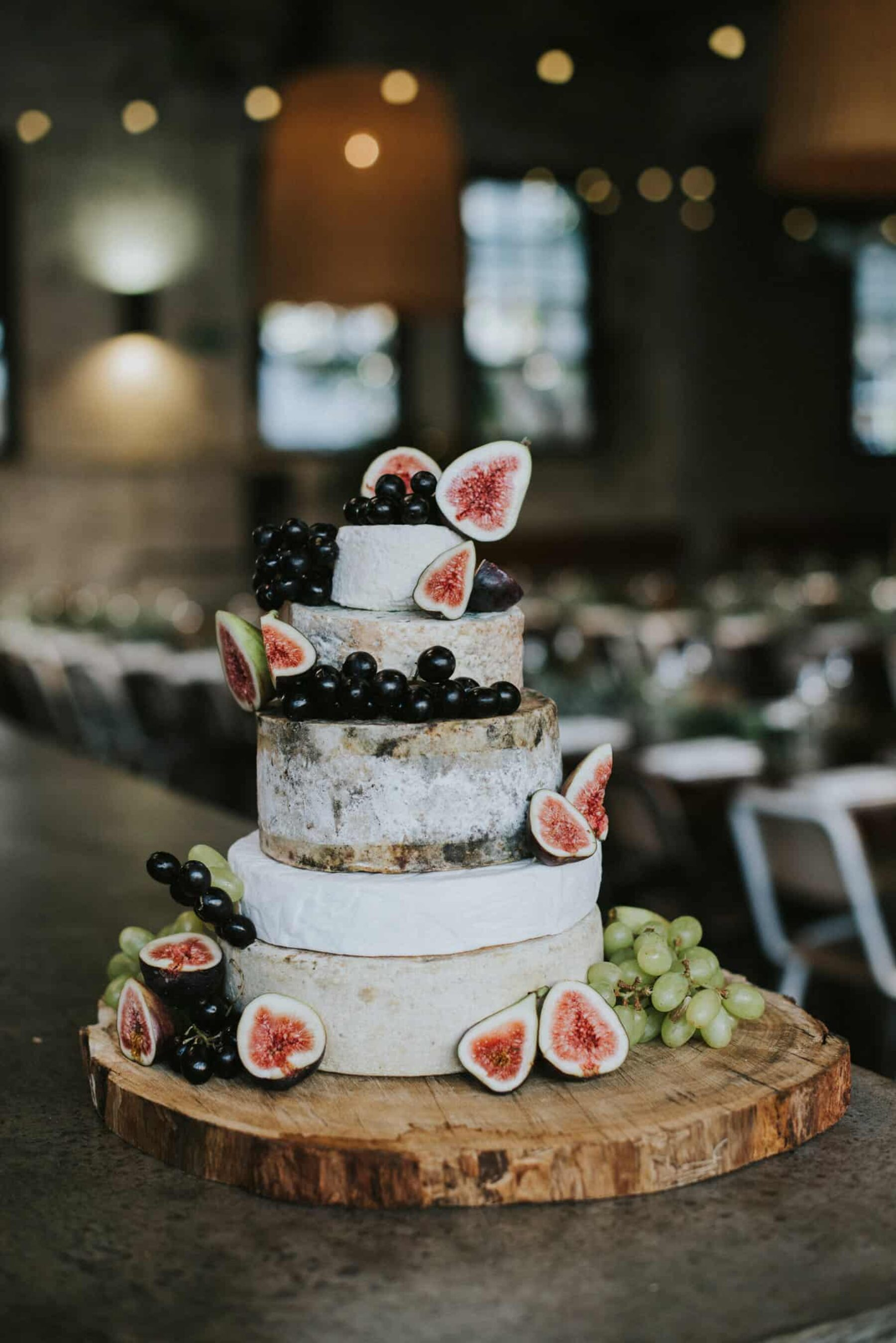 cheese wheel wedding cake with fresh figs