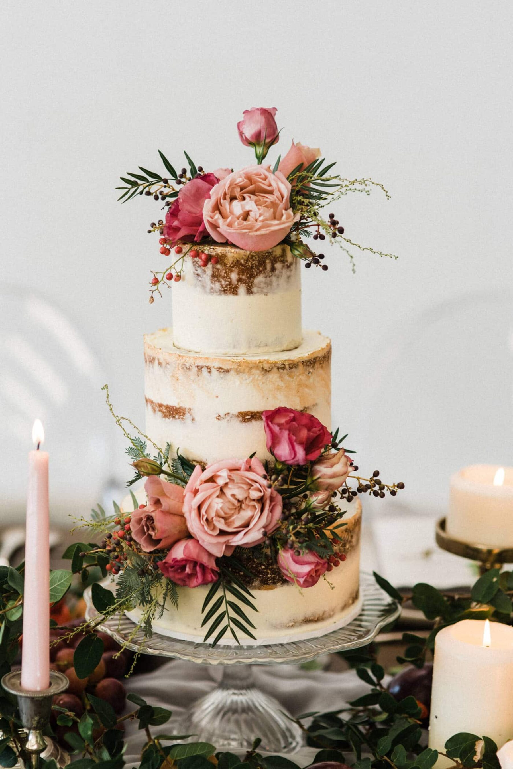 semi-naked layer cake with pink flowers