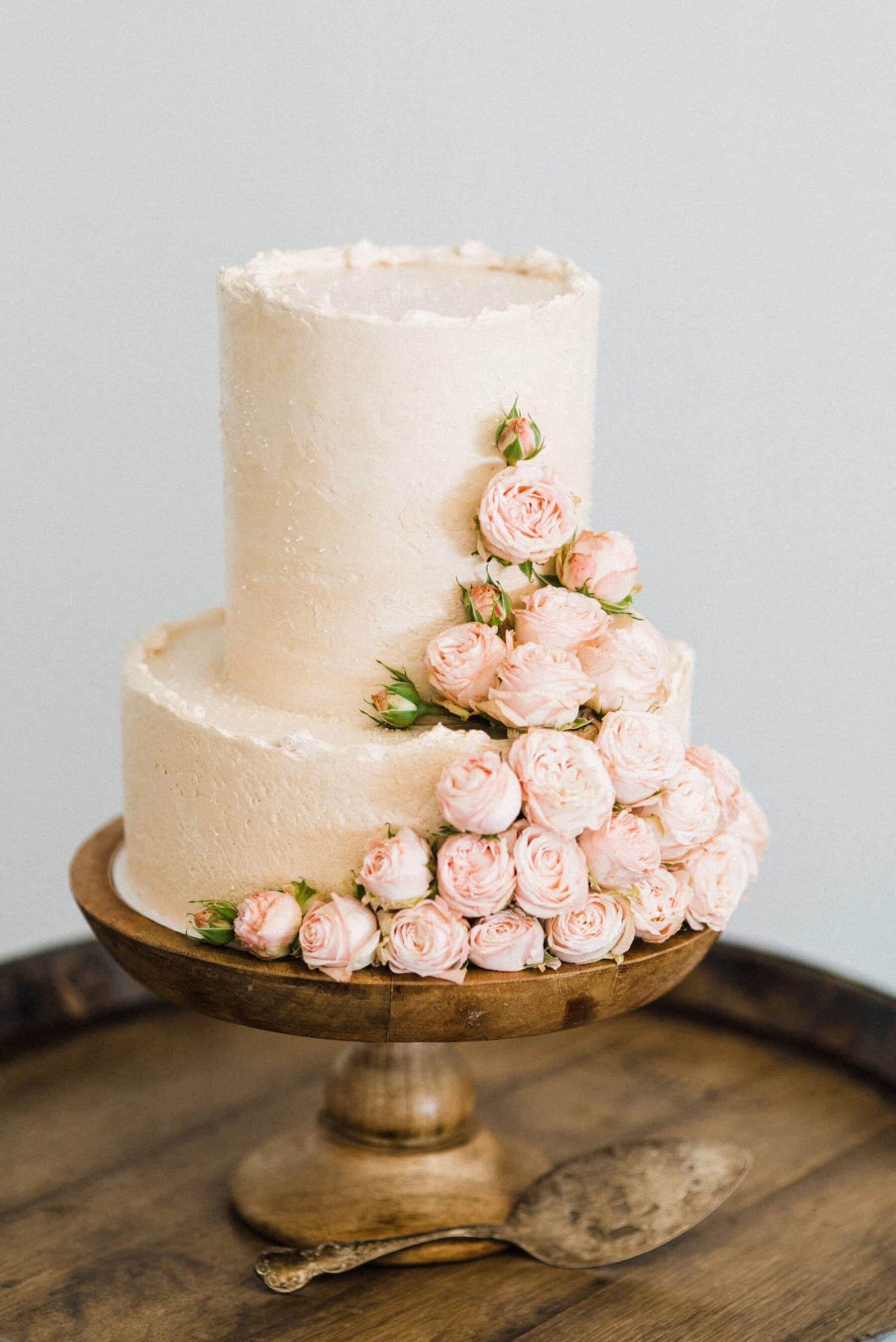 simple blush wedding cake with roses