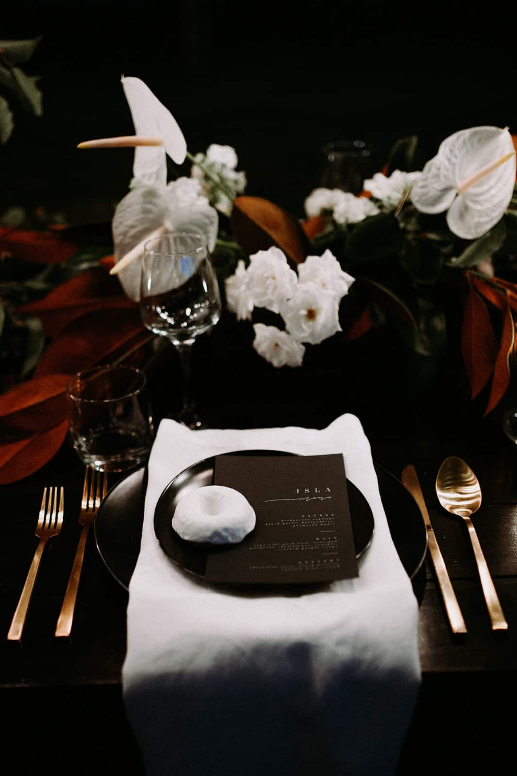 modern tablescape with black crockery and gold cutlery