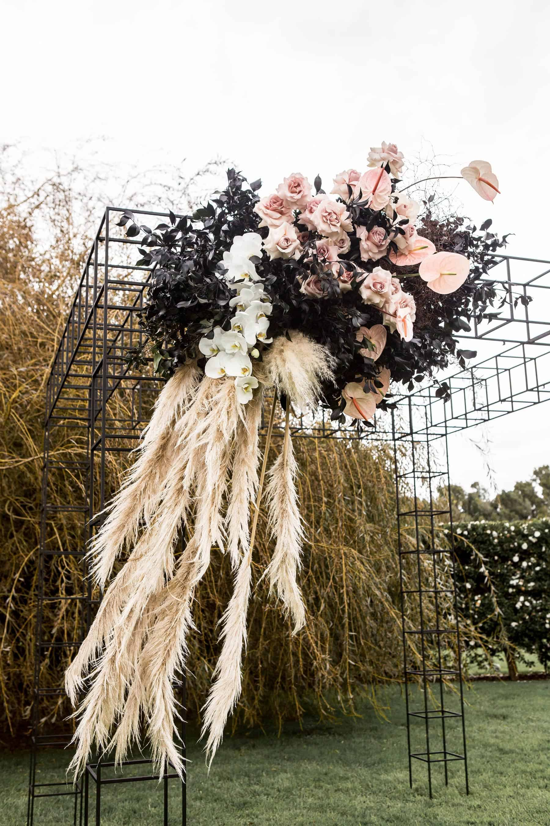 modern wire mesh wedding backdrop with blush flowers and wild grass