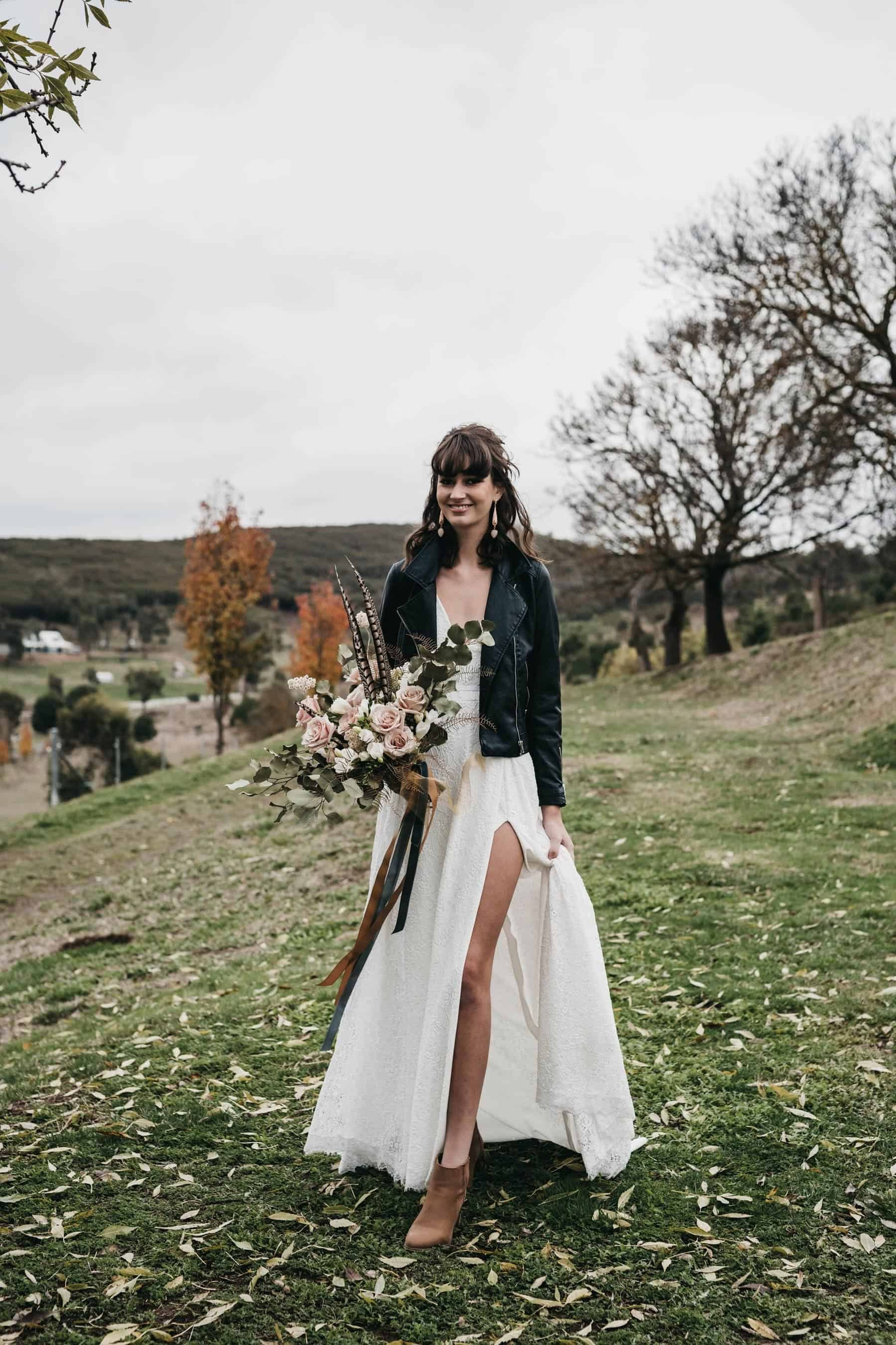 boho bride with black leather jacket