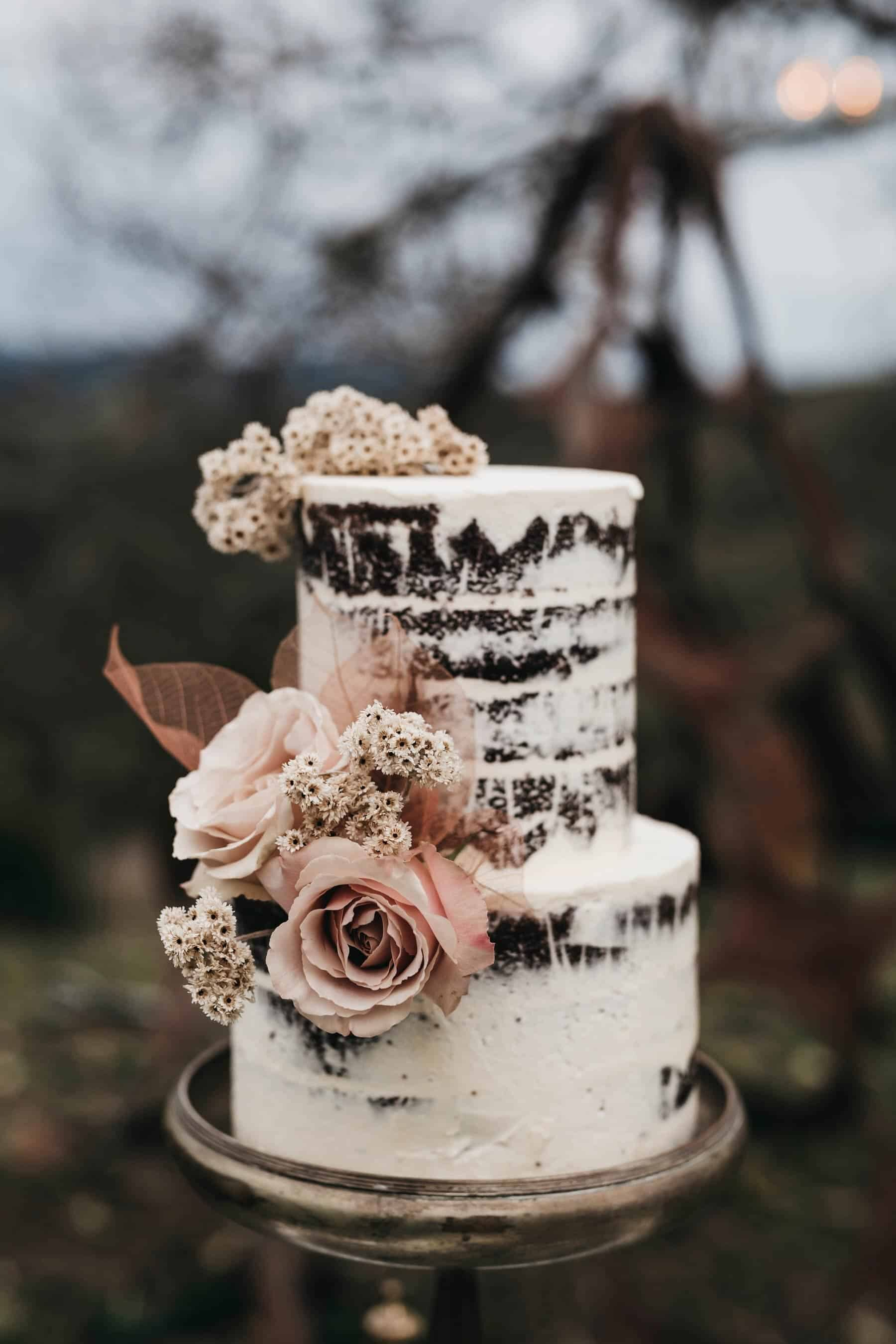 naked wedding cake with blush roses