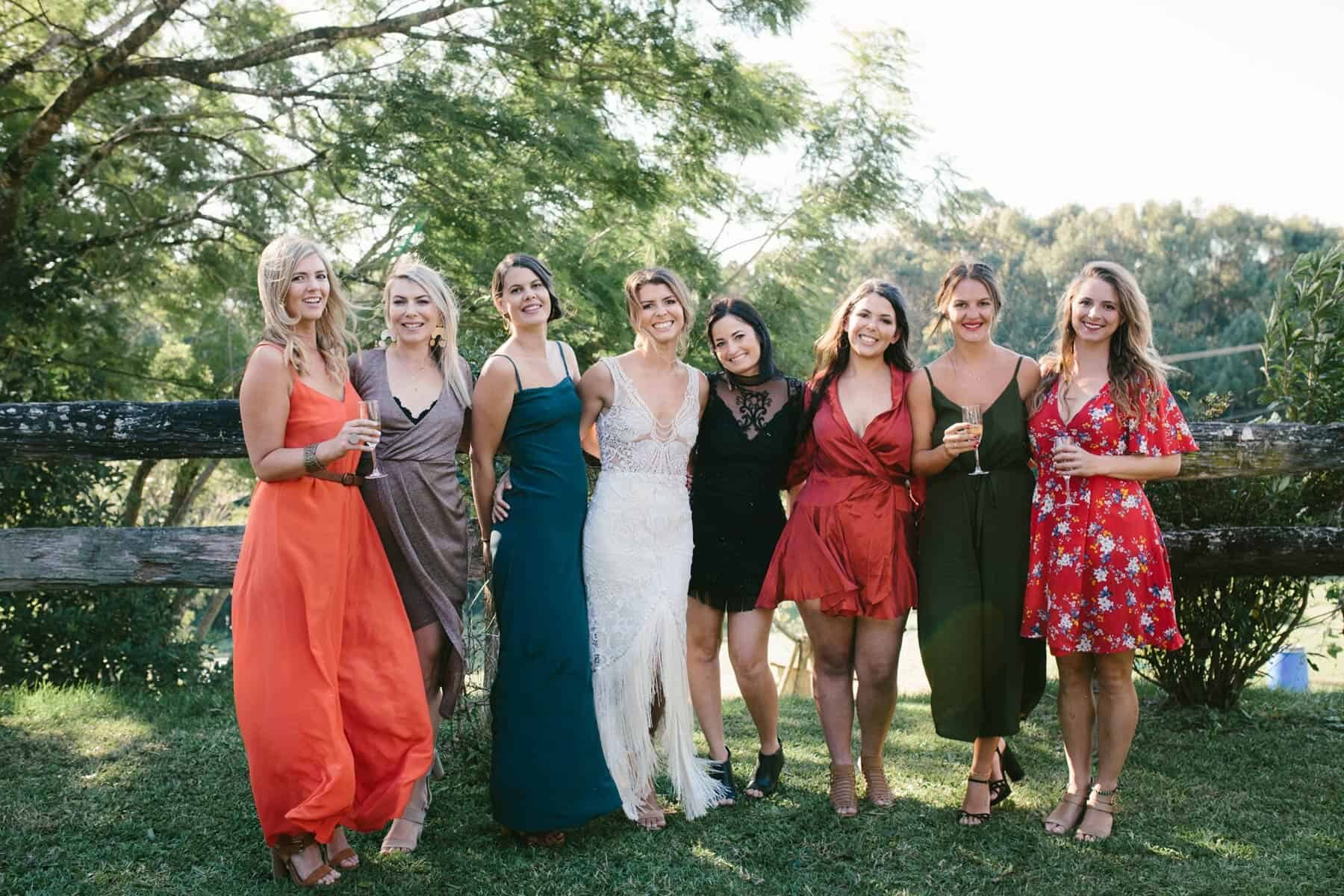 mismatched bridesmaids in warm tones