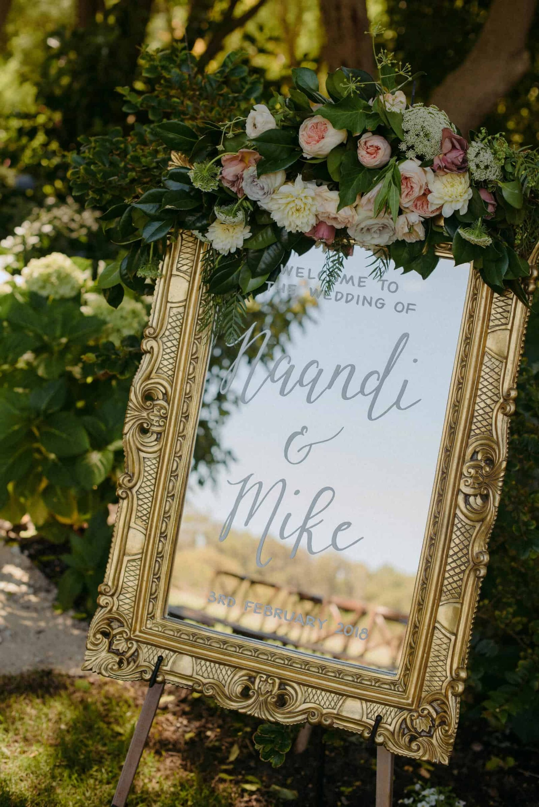 mirror weddding sign with white lettering