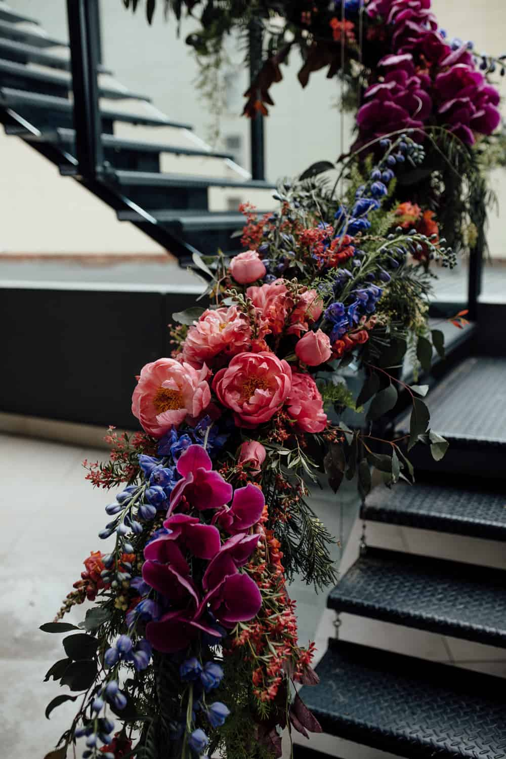 cascading floral installation in vibrant pinks