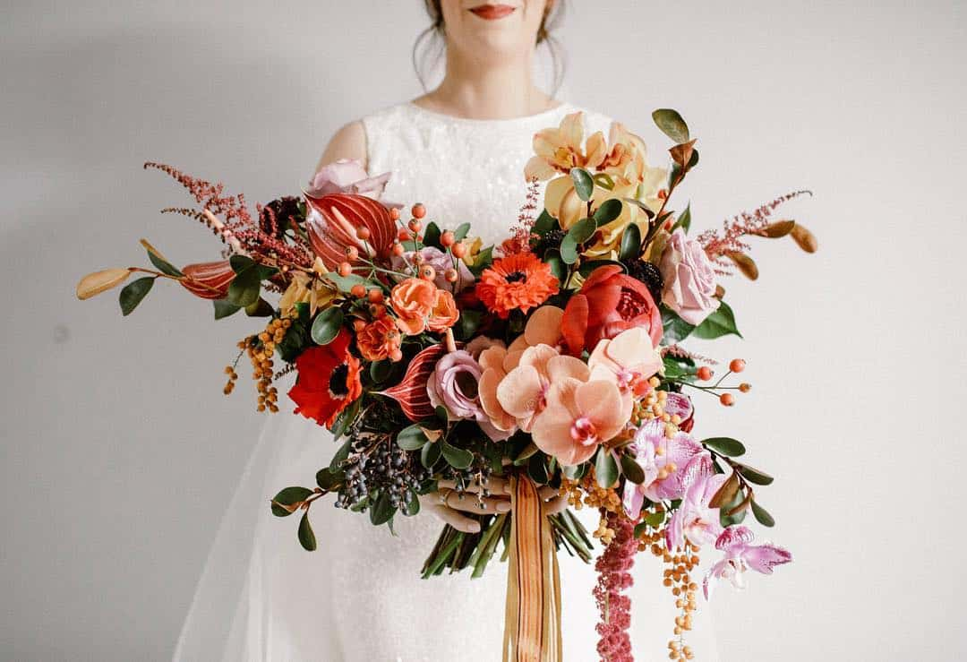 wild, unstructured bridal bouquet with orchids and anthurium