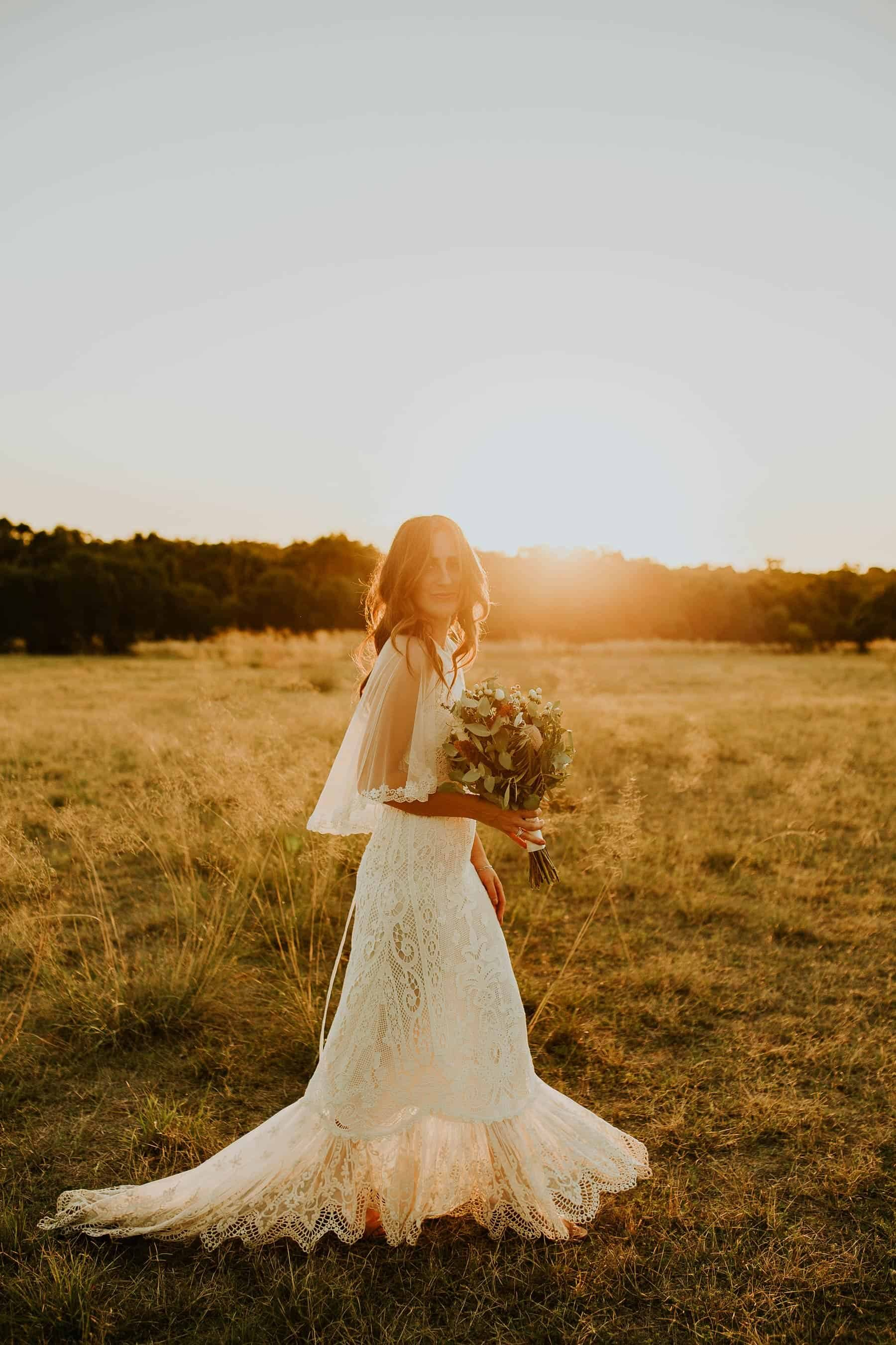 boho bride in lace wedding dress and cape by Spell Designs