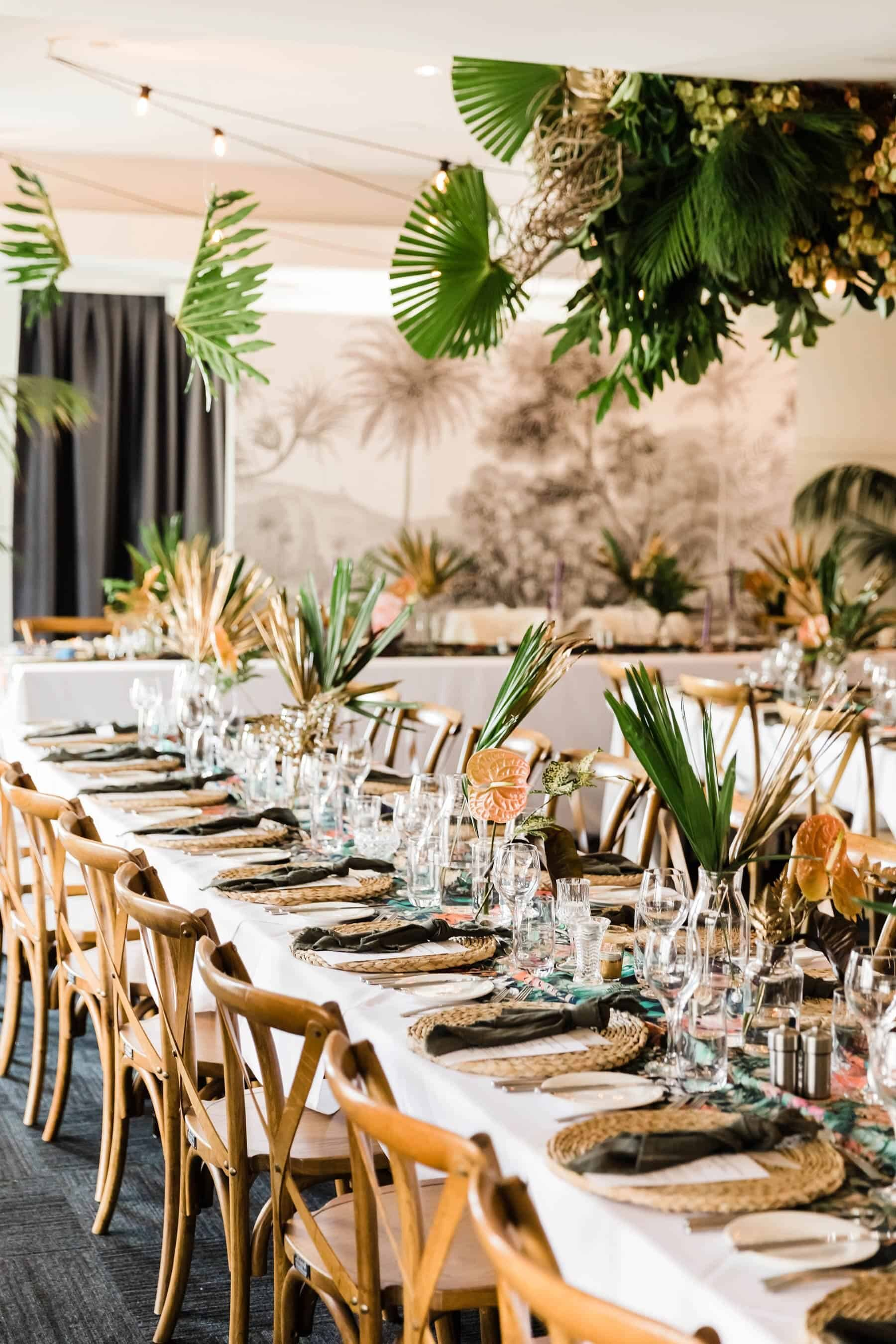 tropical tablescape with hanging greenery