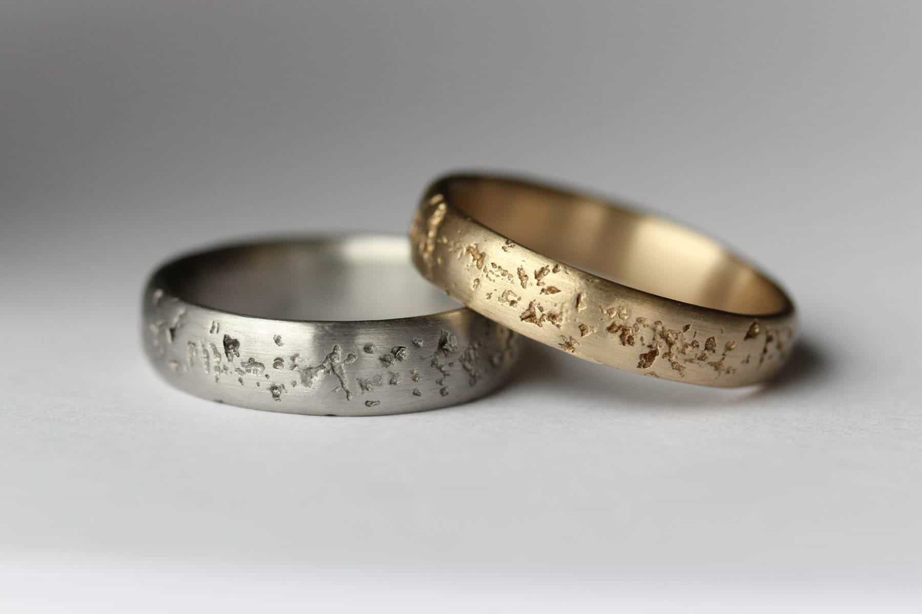 silver and gold textured handmade wedding bands