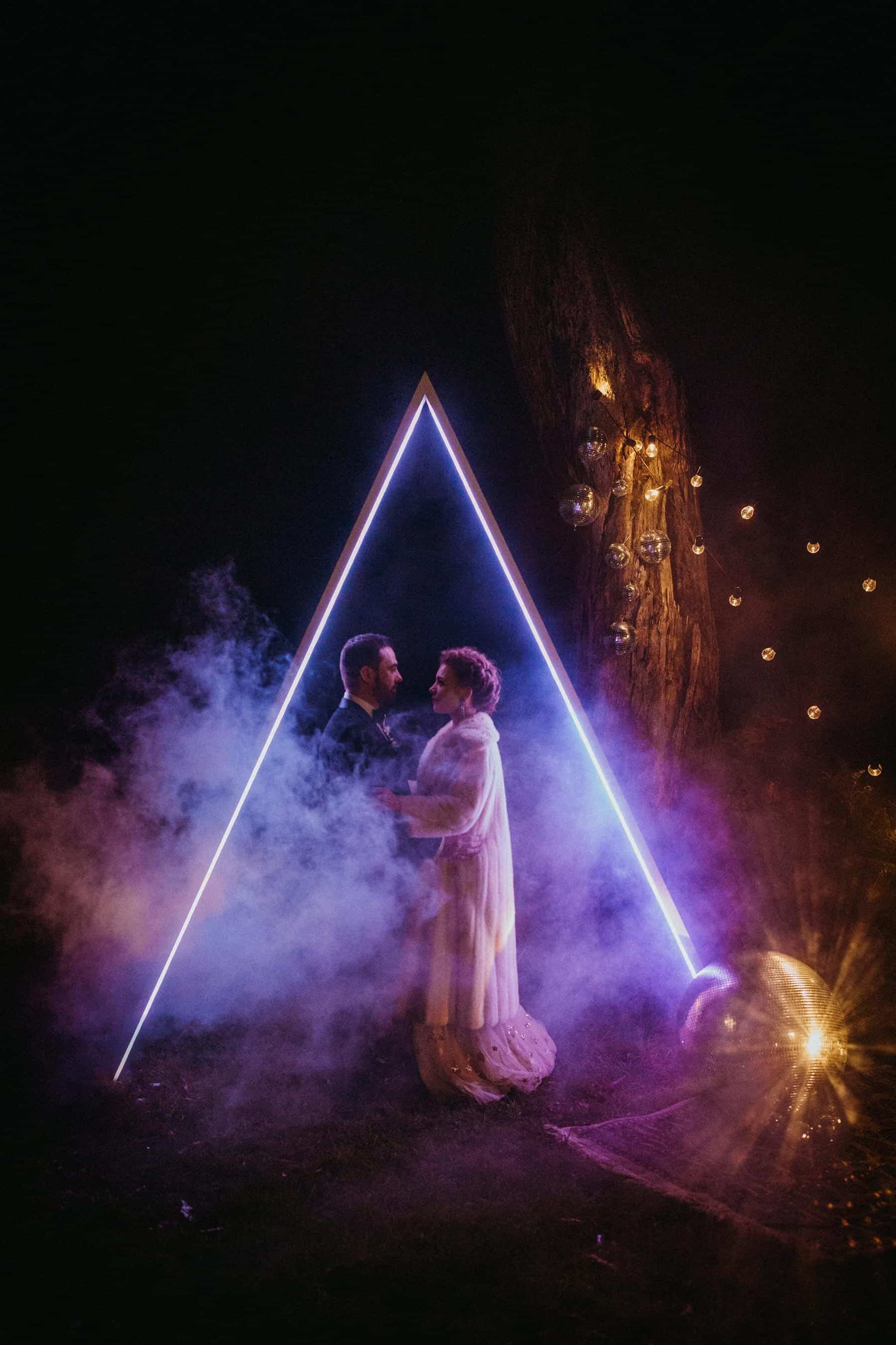 geometric LED illuminated triangle wedding arbours
