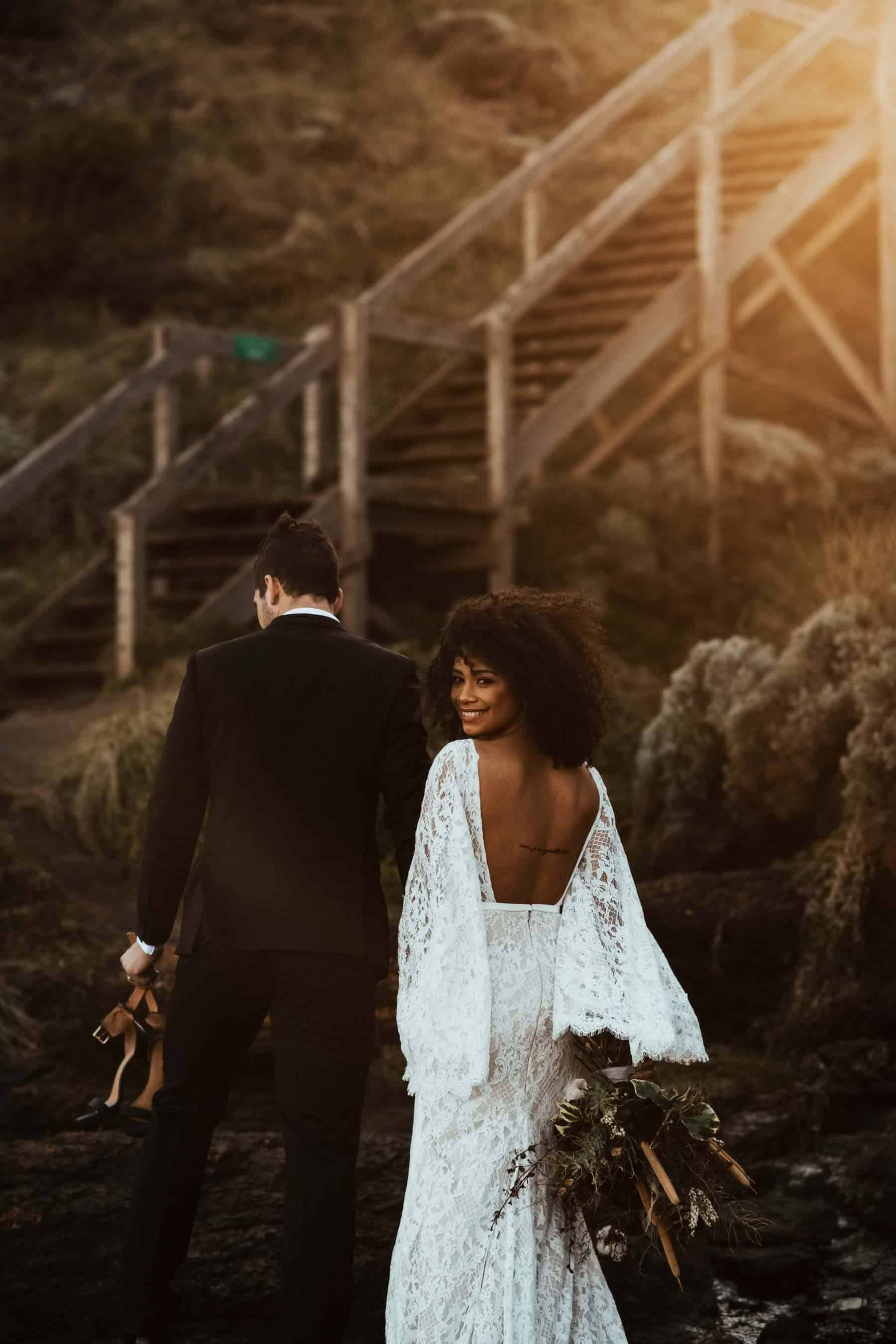 boho bride in backless lace bell sleeve wedding dress