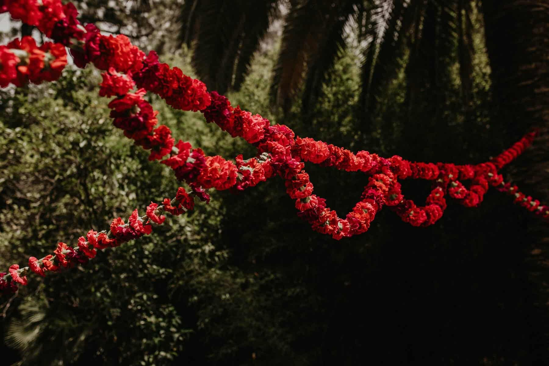 red floral garland for a boho wedding