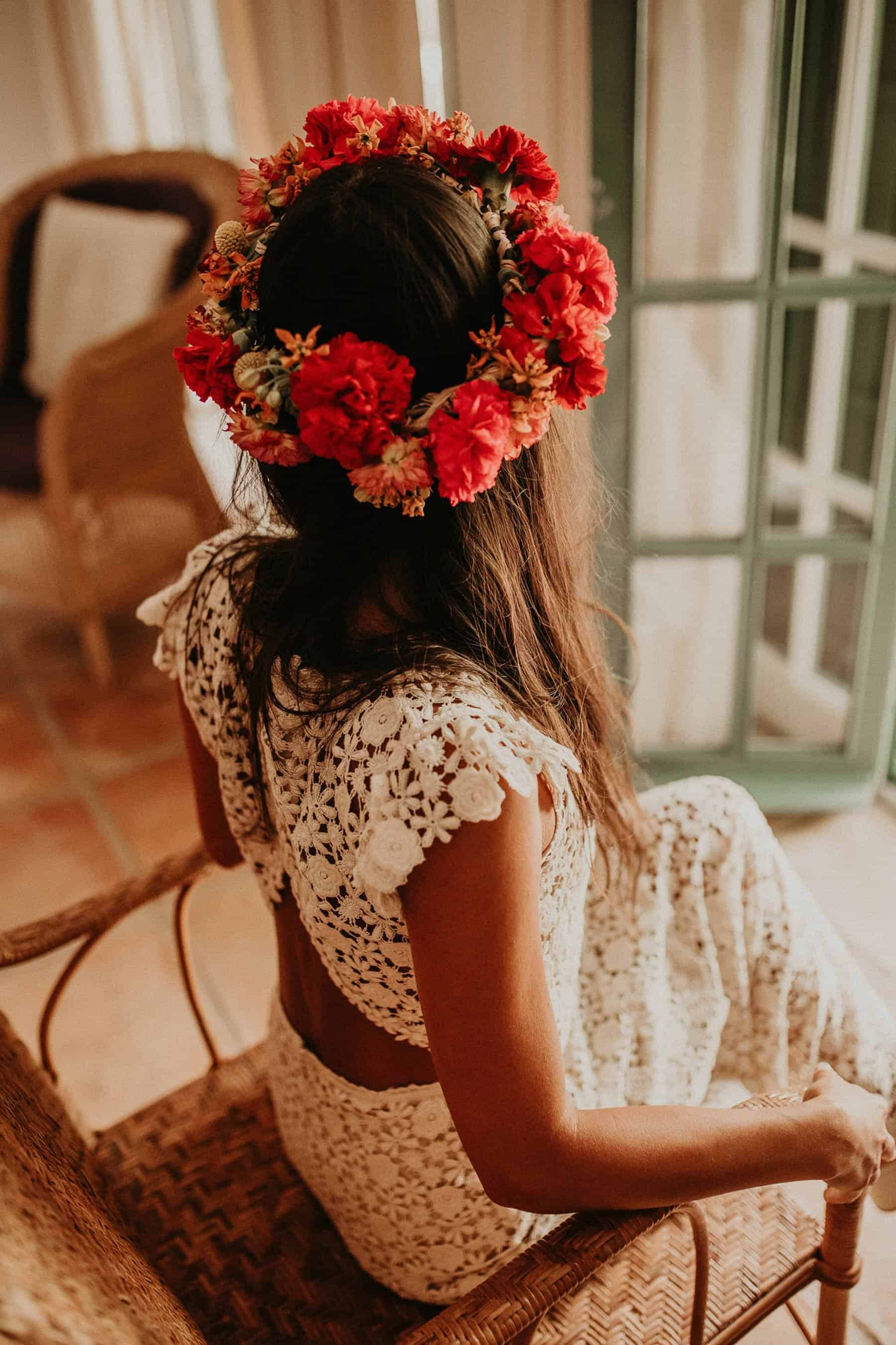 boho bride in two piece crochet wedding dress and Frida Kahlo flower crown