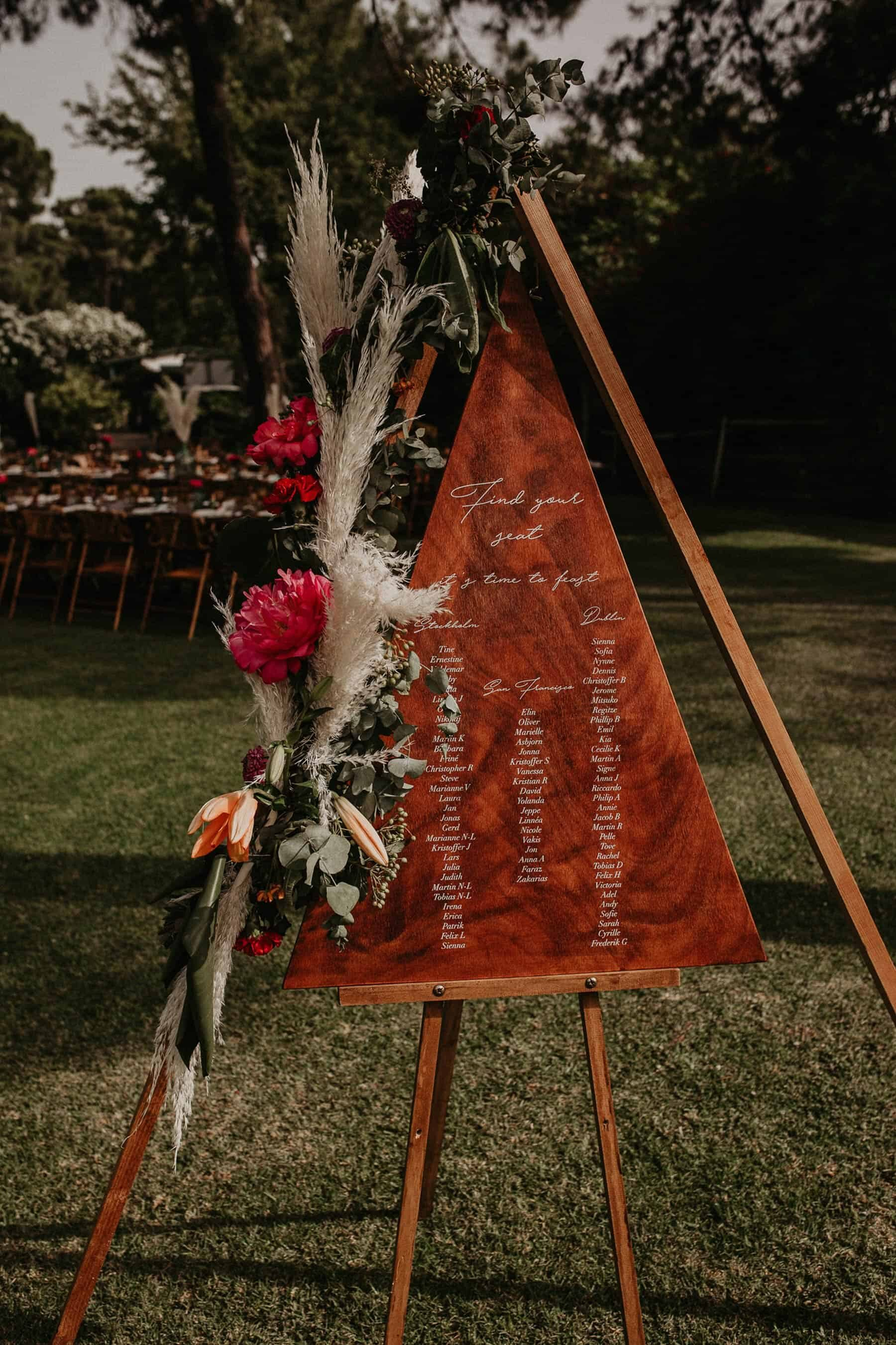 geometric triangle wooden seating planner with pampas grass