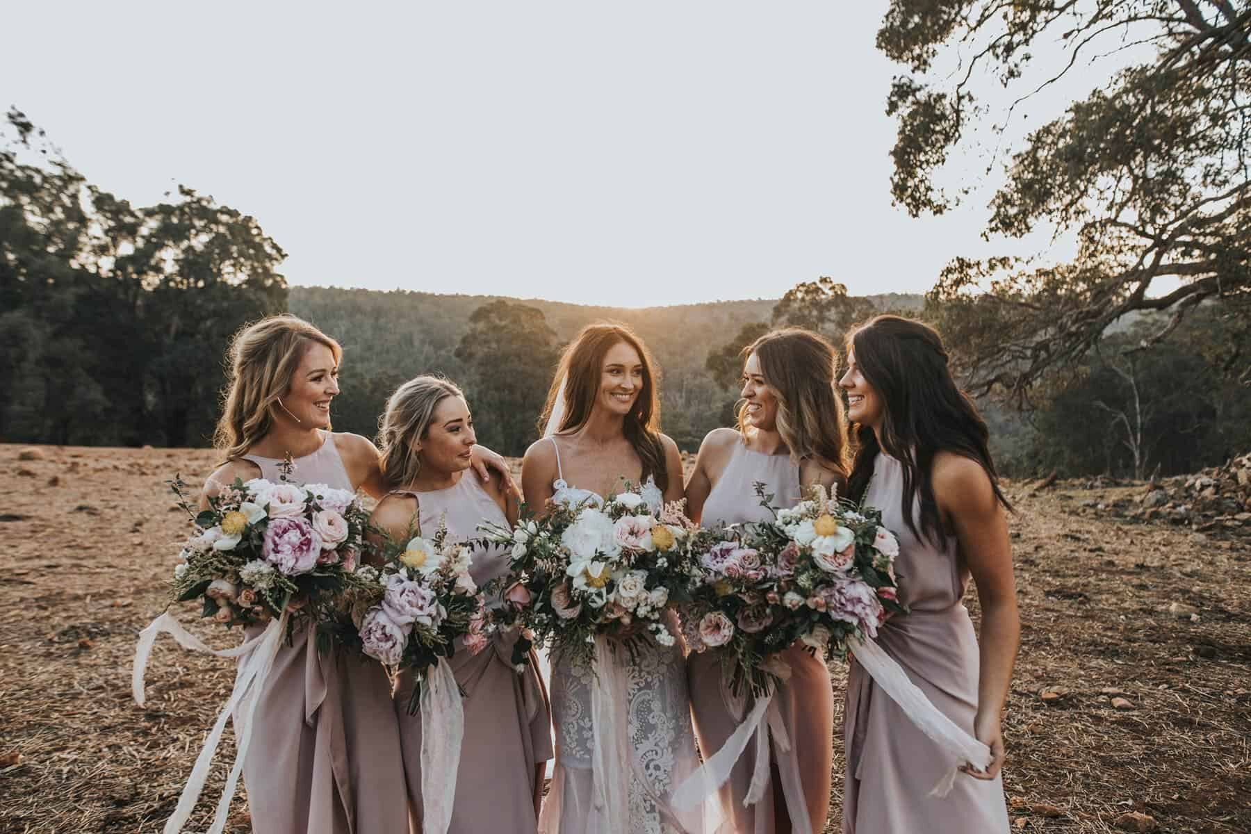 modern blush bridesmaid dresses and wild bouquets
