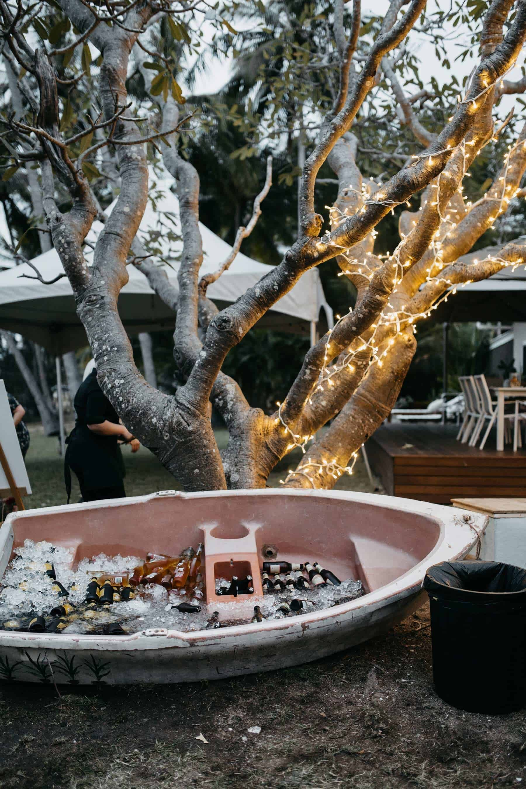 backyard wedding ideas - old boat used for drinks tub