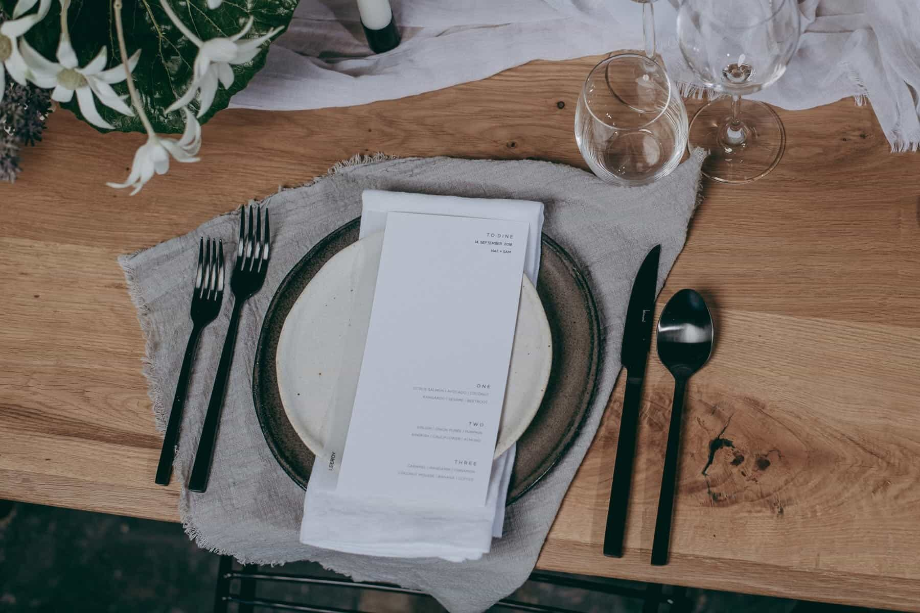 minimal organic table setting black cutlery