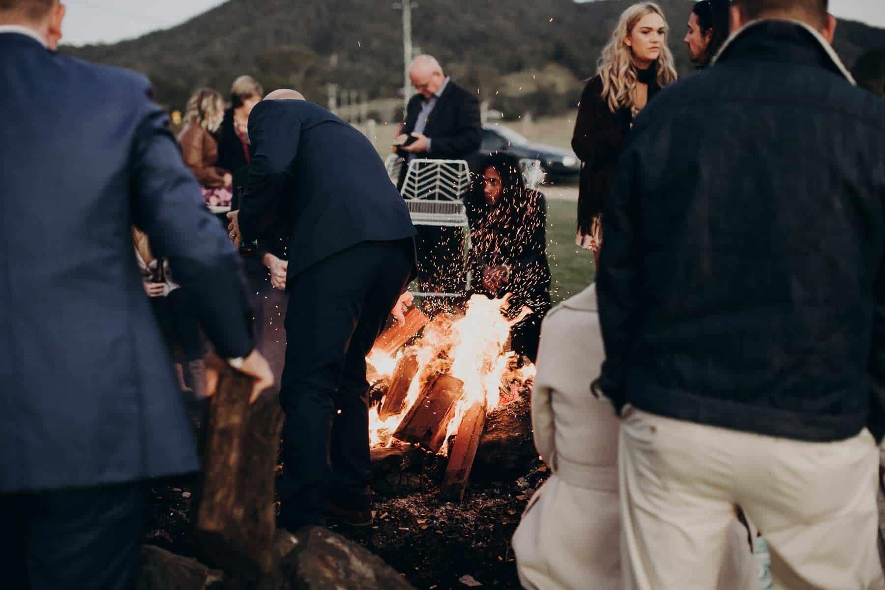 rutic outdoor wedding with bonfire
