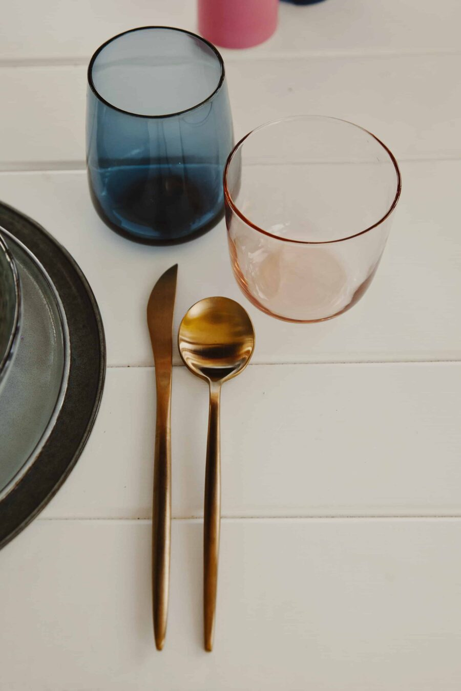 modern mid-century inspired tablescape with coloured glassware