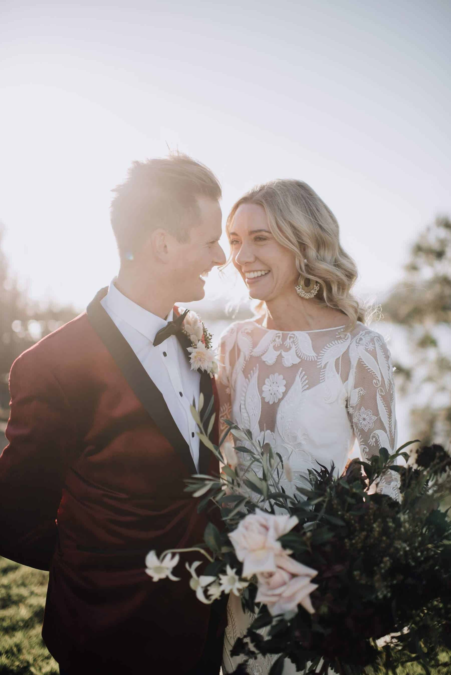 boho bride and groom in burgundy jacket