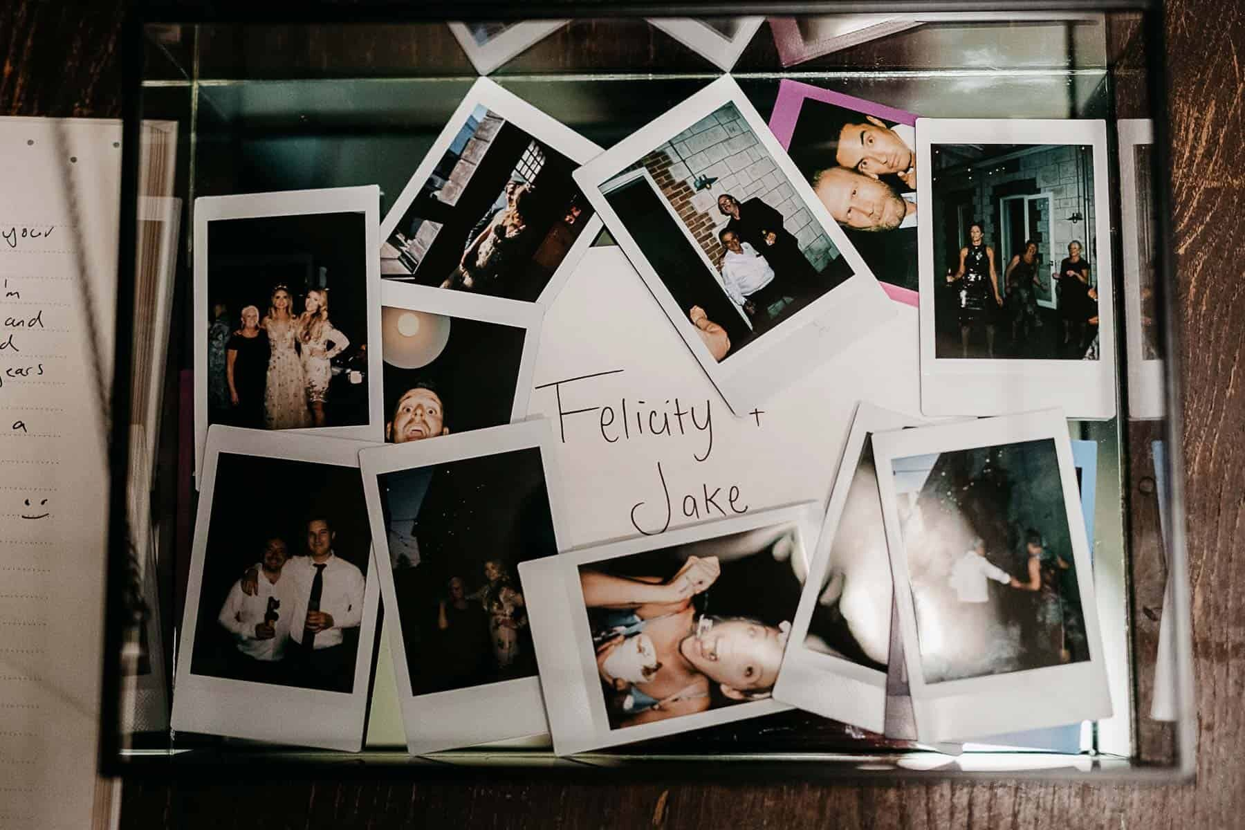 Polaroids in table for wedding reception