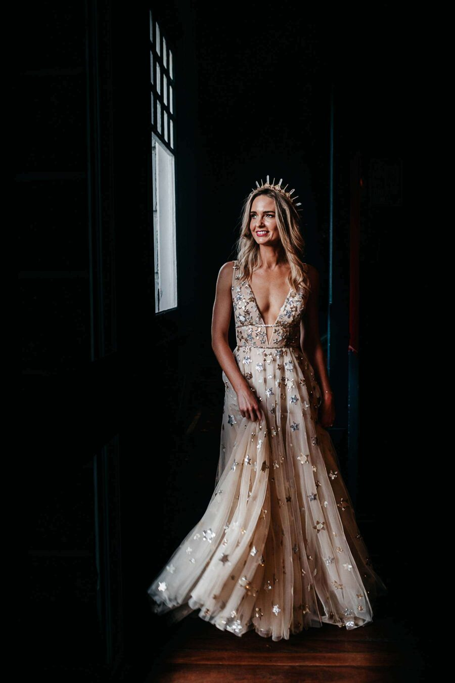 bride wears gold willowby by watters with gold amaroq crown