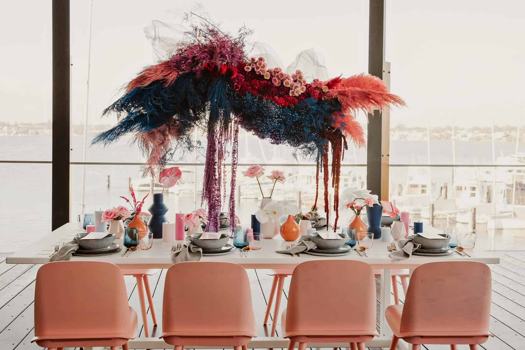bright pink floral installation over tablescape