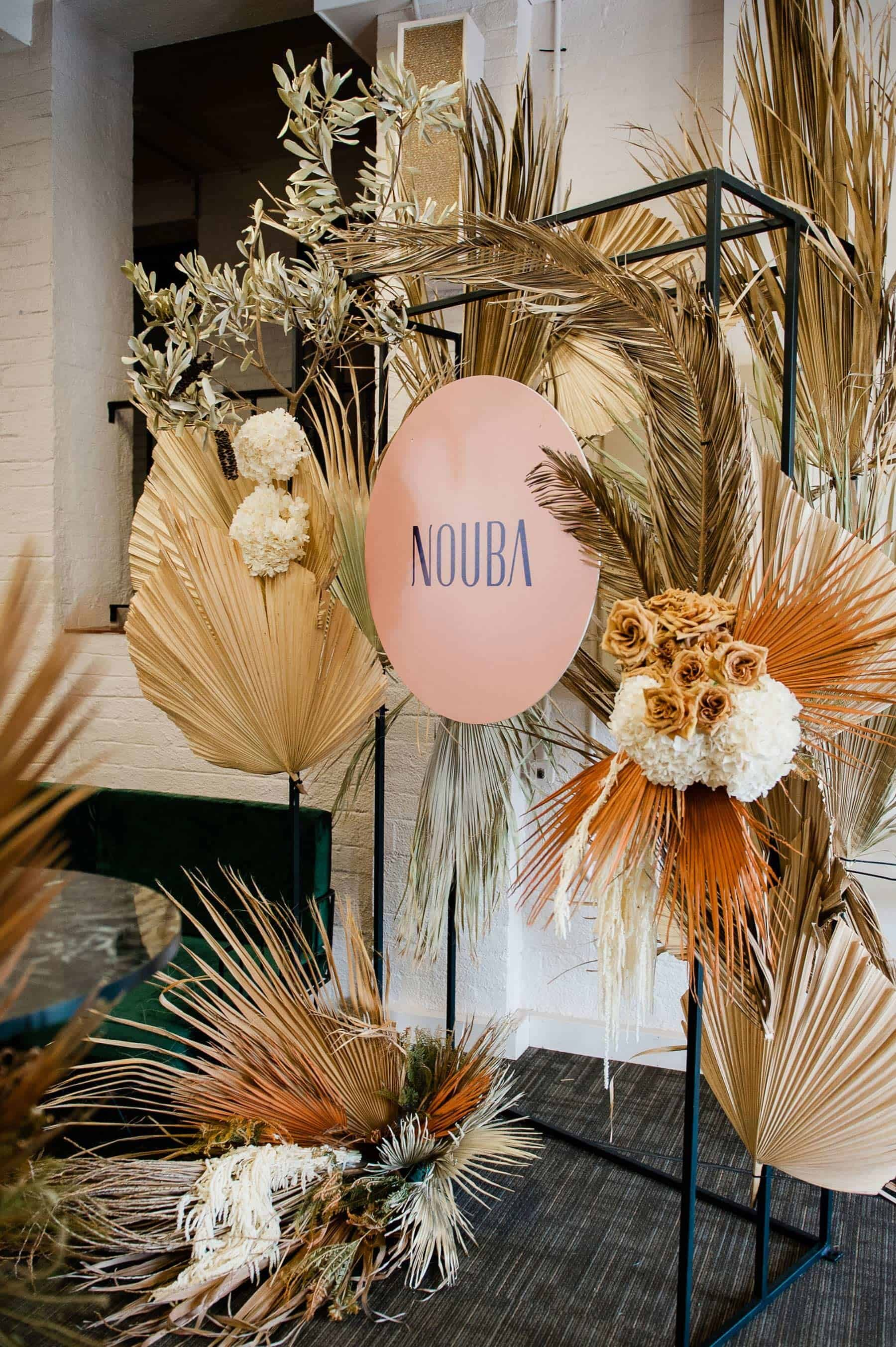 floral installation with dried palm leaves