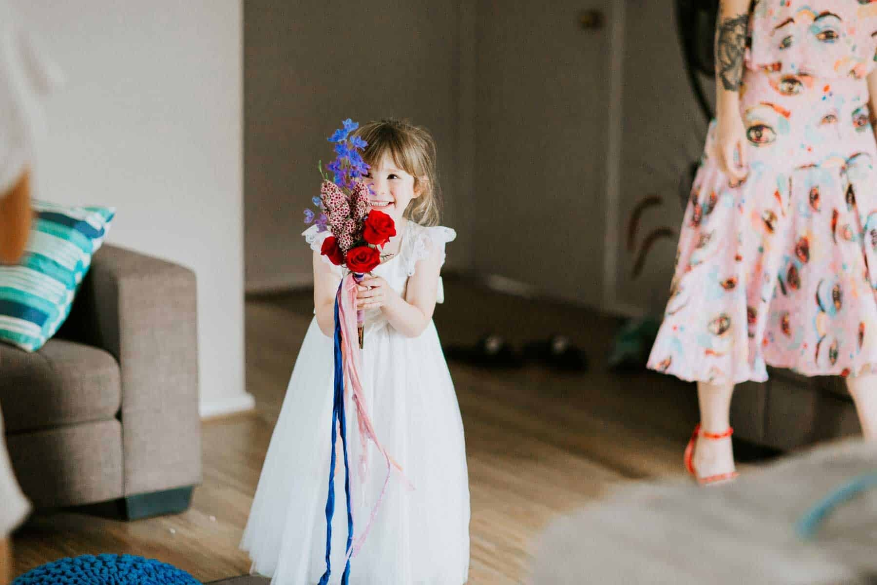 flower girl with colourful bouquet