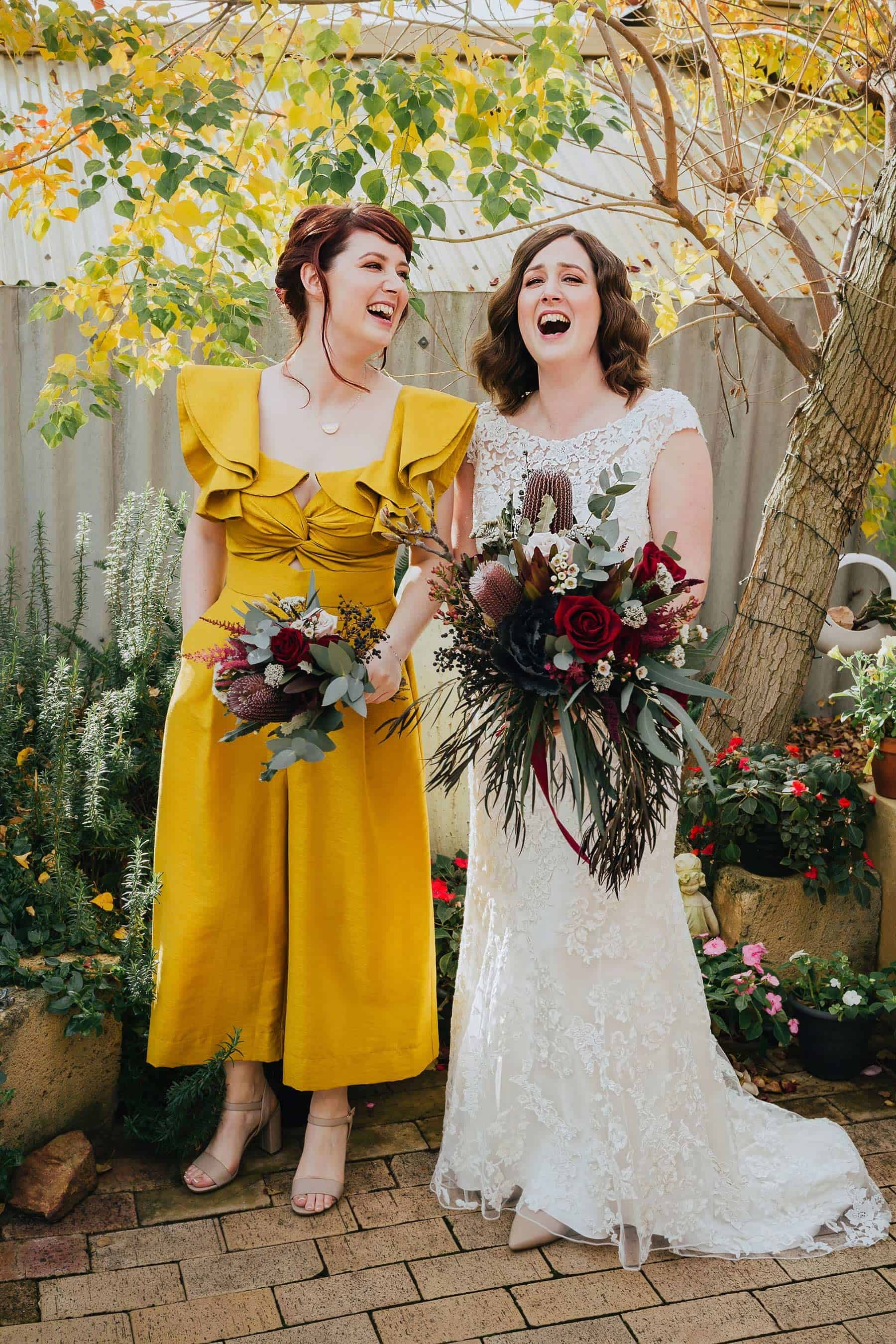 Bridesmaid in yellow jumpsuit
