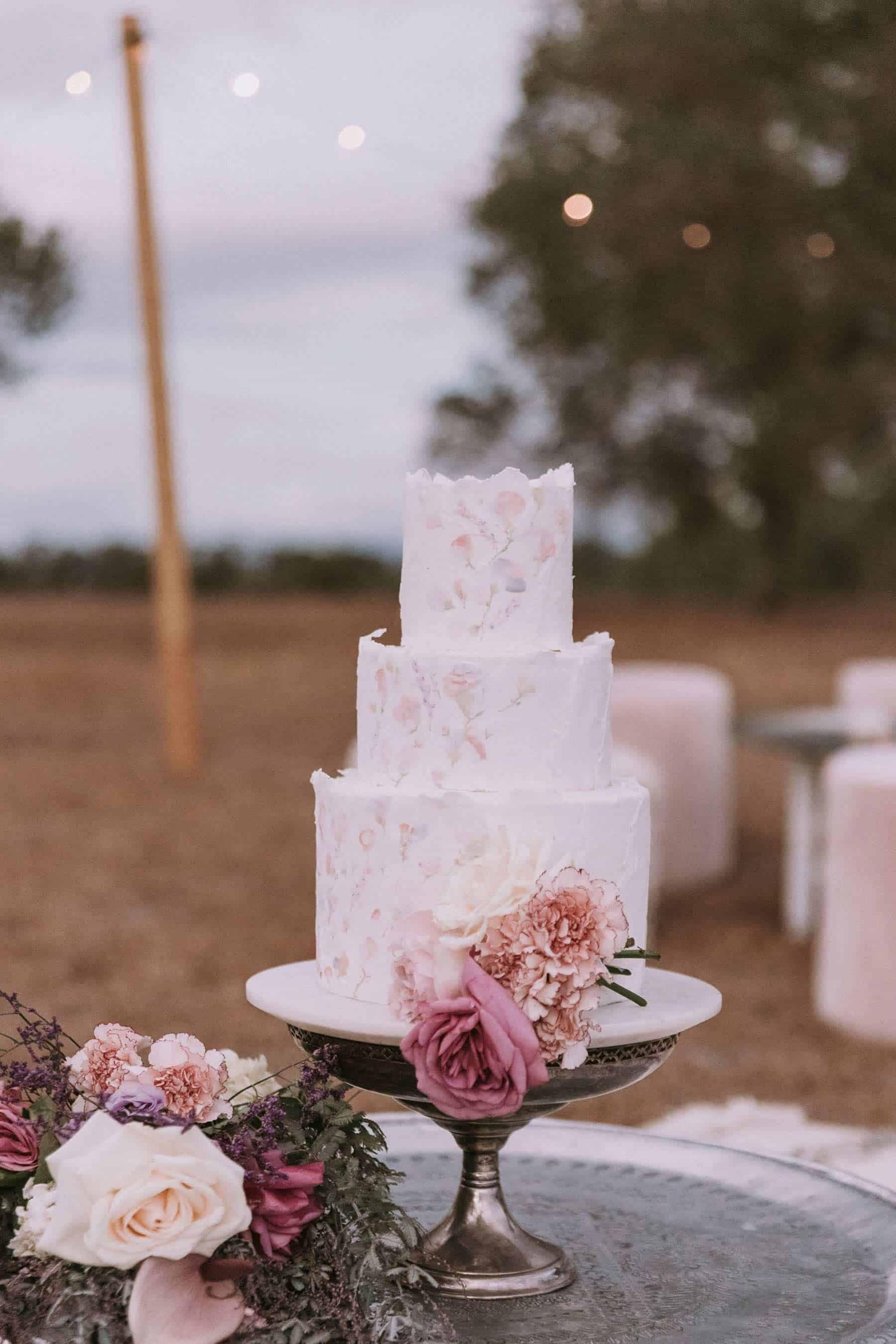 three tier blush wedding cake